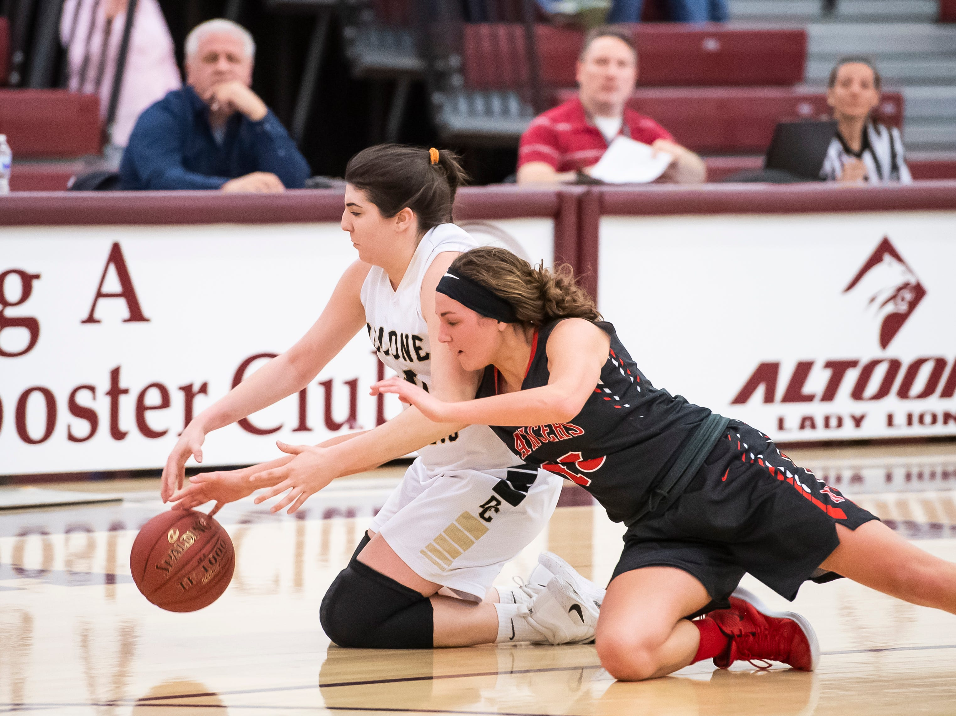 Delone Catholic's Bradi Zumbrum maintains possession as Neshannock's Isabella Burrelli tries to make a steal during a PIAA 3A quarterfinal in Altoona, Pa., on Friday, March 15, 2019. The Squirettes won 50-41.