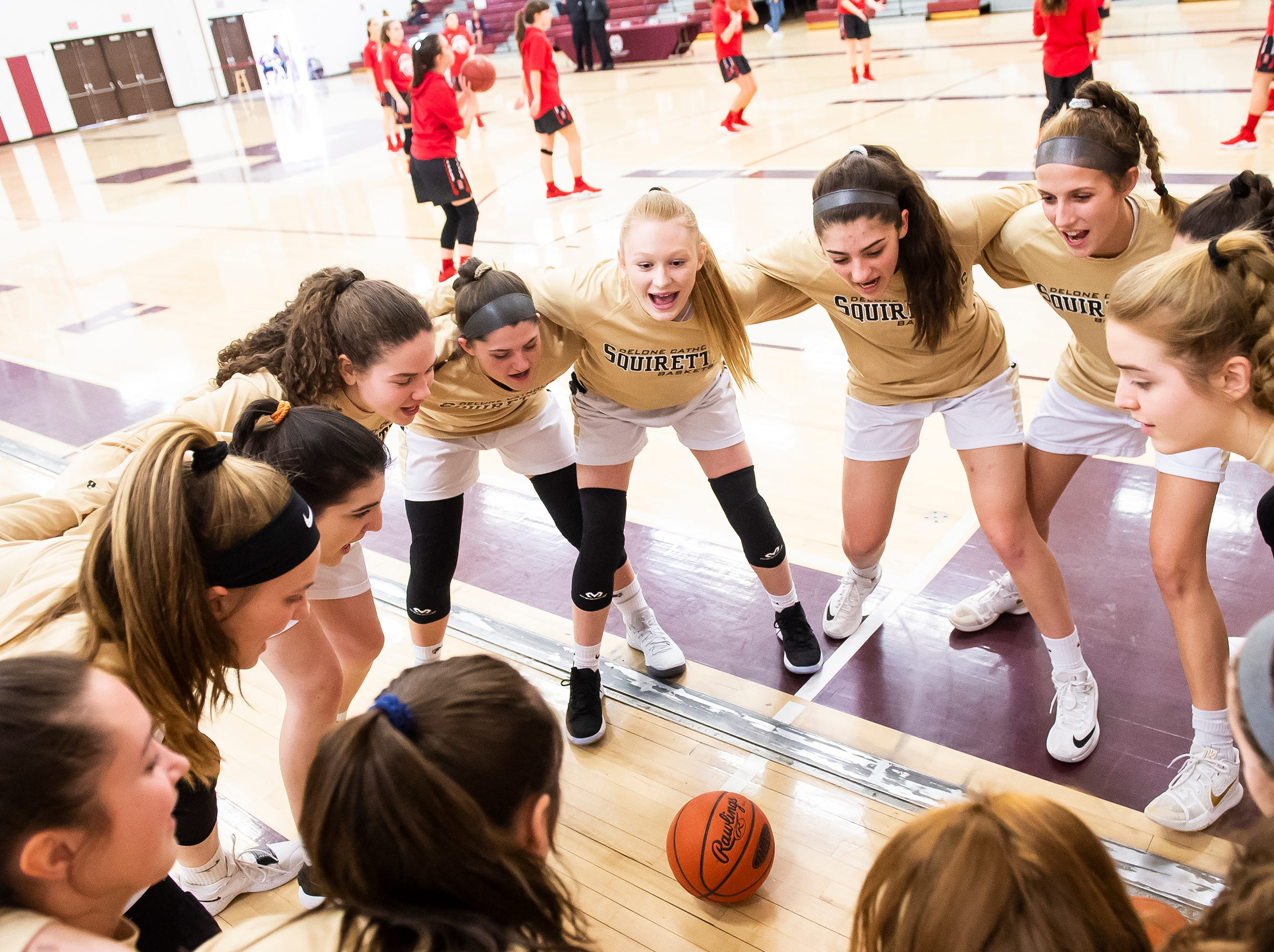 The Delone Catholic Squirettes get pumped up before playing Neshannock during a PIAA 3A quarterfinal in Altoona, Pa., on Friday, March 15, 2019. The Squirettes won 50-41.