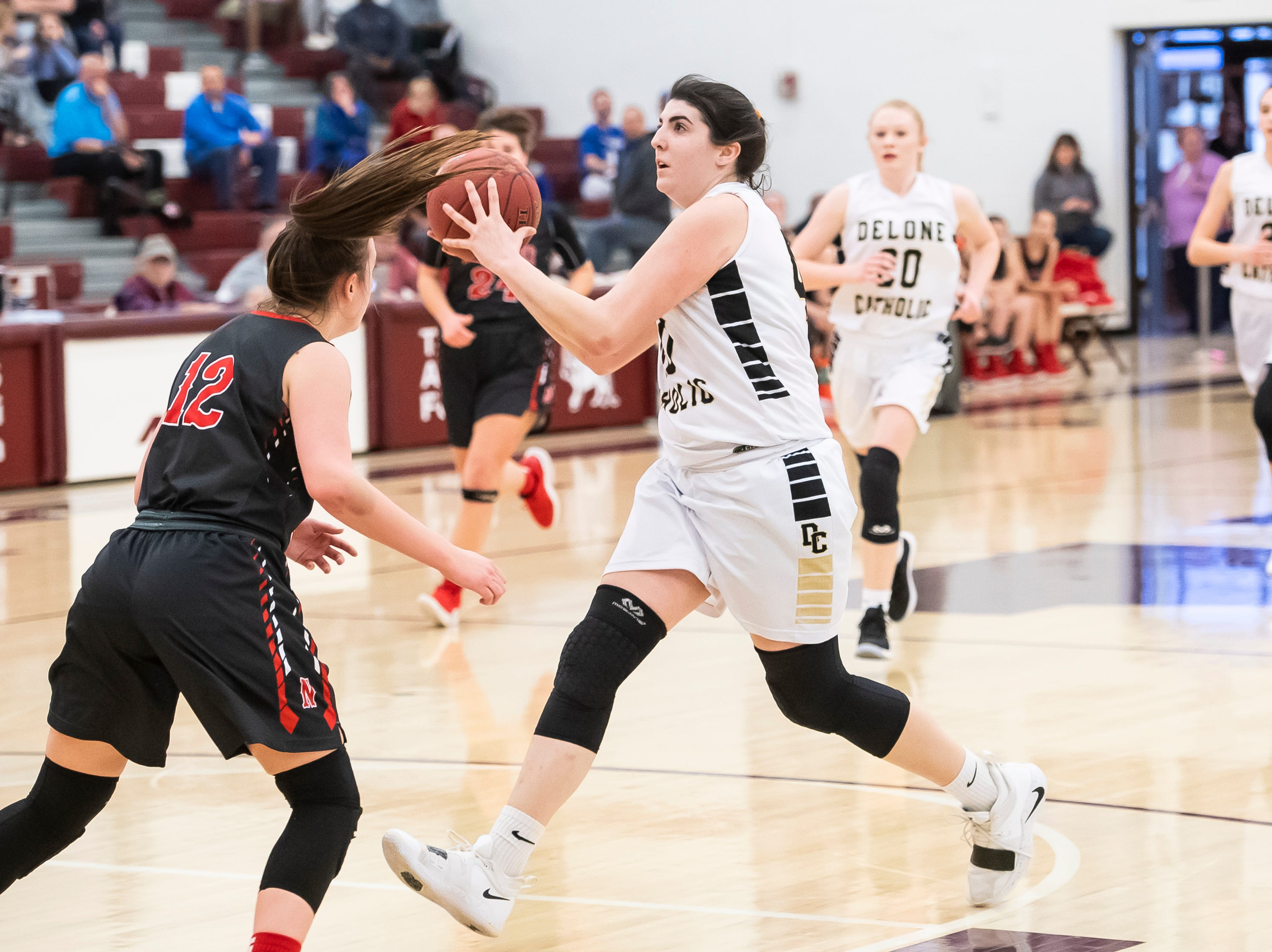 Delone Catholic's Bradi Zumbrum prepares to shoot a layup during a PIAA 3A quarterfinal game against Neshannock in Altoona, Pa., on Friday, March 15, 2019. The Squirettes won 50-41.