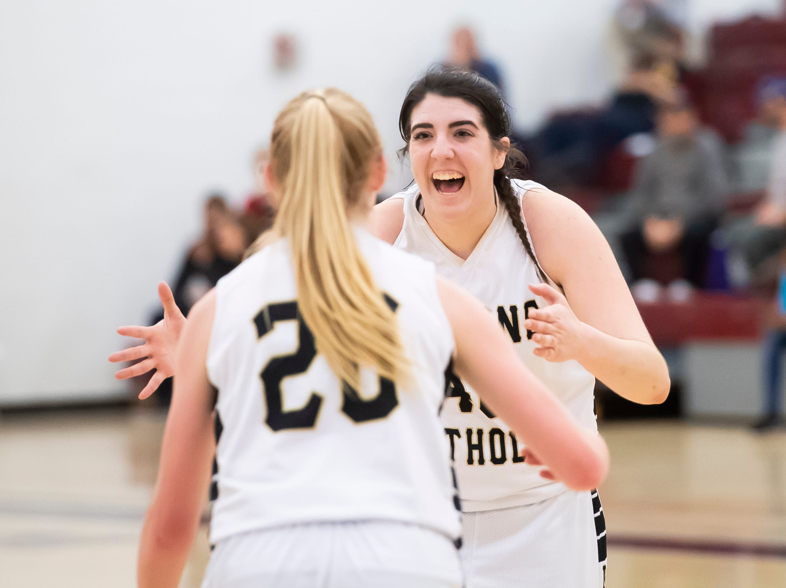 Delone Catholic's Bradi Zumbrum and Brooke Lawyer (20) celebrate after defeating Neshannock 50-41 during a PIAA 3A quarterfinal in Altoona on Friday, March 15, 2019. Zumbrum led all scorers with 16 points and reached the 1,000 career points mark.
