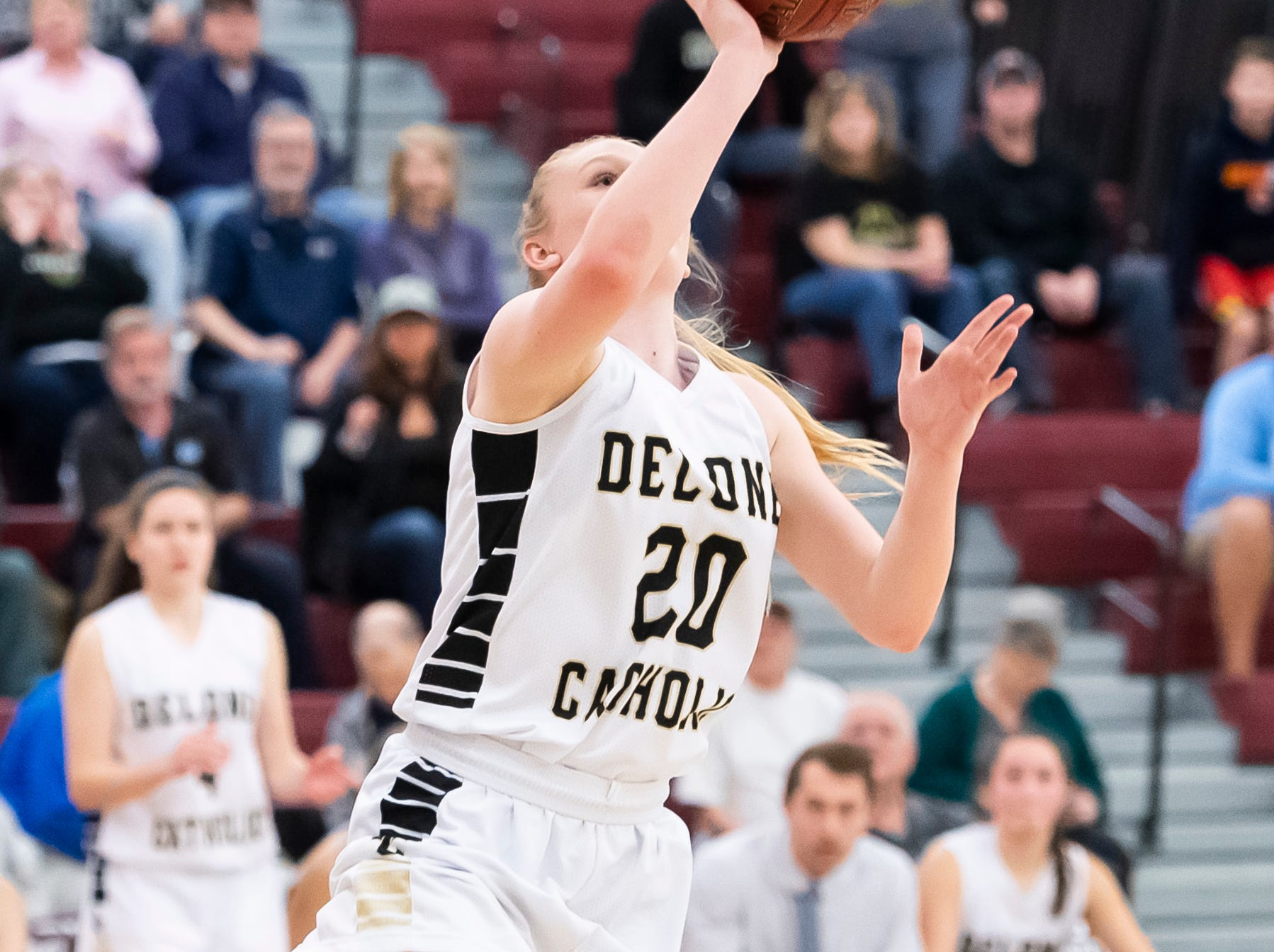 Delone Catholic's Brooke Lawyer shoots and scores on a layup late in the fourth quarter against Neshannock during a PIAA 3A quarterfinal in Altoona, Pa., on Friday, March 15, 2019. The Squirettes won 50-41.