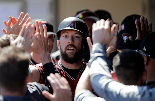Arizona Diamondbacks' Steven Souza Jr. is congratulated after scoring against the Chicago Cubs in the first inning of a spring training baseball game Saturday, March 16, 2019, in Scottsdale, Ariz.