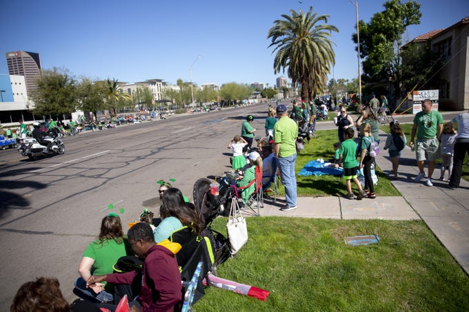 People wearing green line the sides of Third Street for the Phoenix St. Patrick's Day Parade on March 16, 2019.