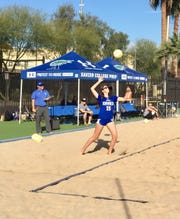 Xavier Prep beach volleyball coach Tim McHale takes note as his player Grace Lincoln (15) serves in a match against Tempe Corona del Sol on March 1, 2019.