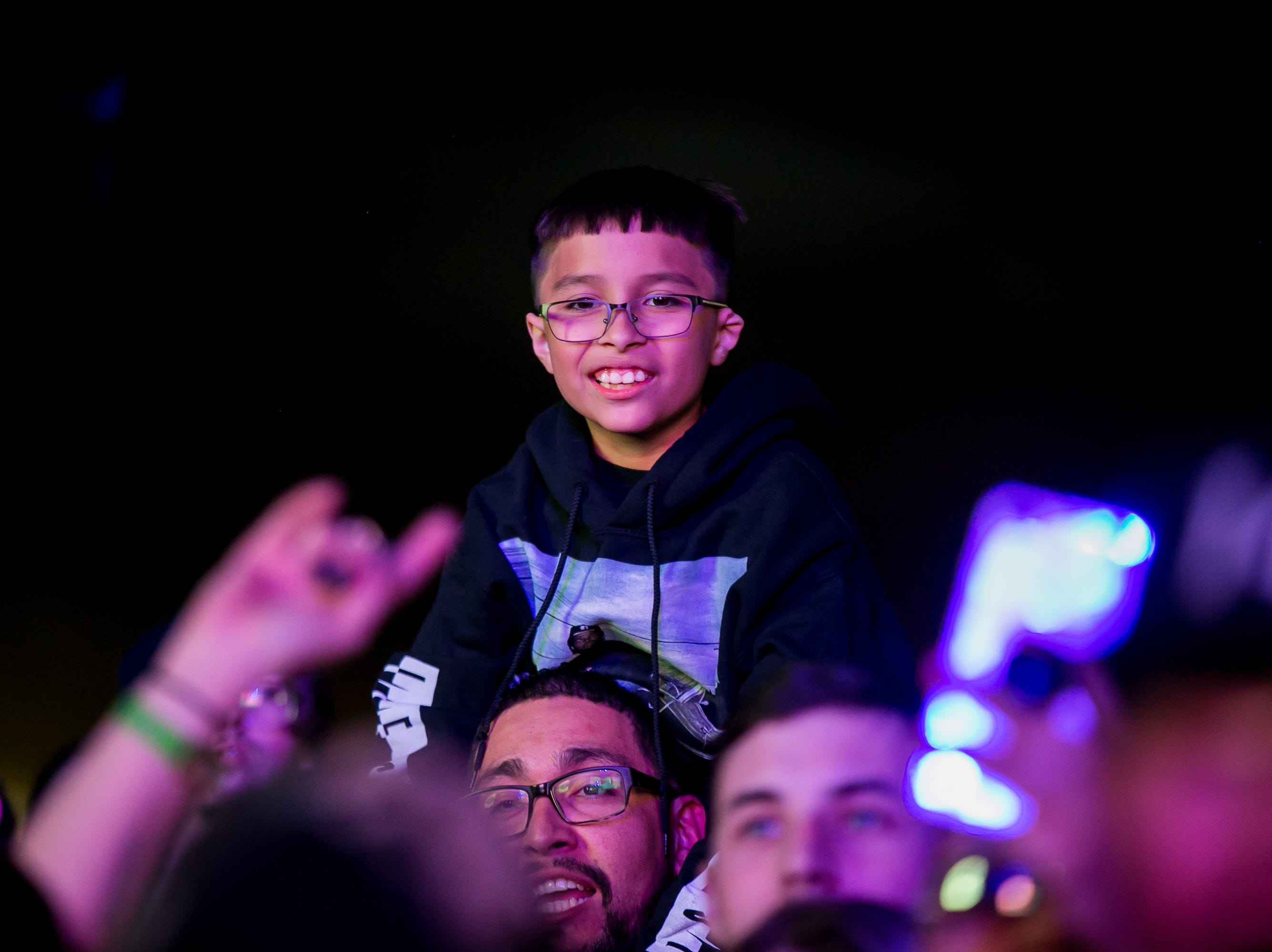 A young man enjoyed a performance at Pot of Gold Music Festival at Steele Indian School Park on Friday, March 15, 2019.