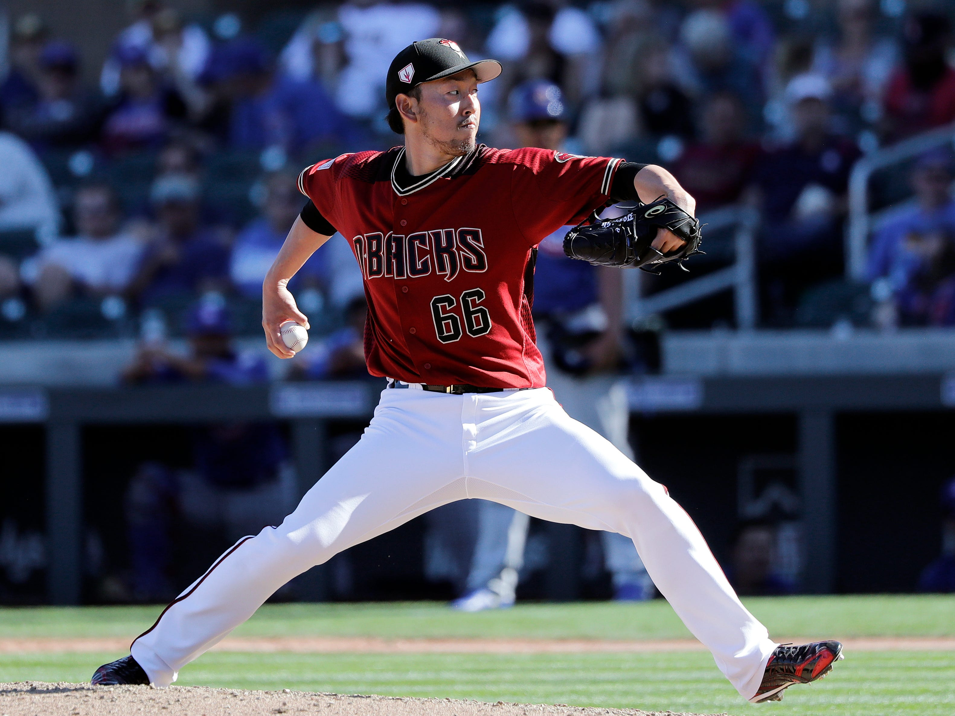 Arizona Diamondbacks' Yoshihisa Hirano throws against the Chicago Cubs in the eighth inning of a spring training baseball game Saturday, March 16, 2019, in Scottsdale, Ariz.