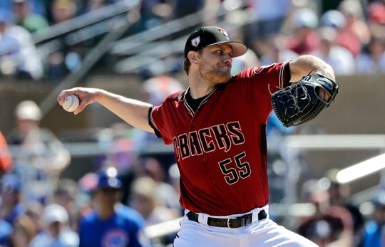 Arizona Diamondbacks starting pitcher Matt Koch throws against the Chicago Cubs in the first inning of a spring training baseball game Saturday, March 16, 2019, in Scottsdale, Ariz.