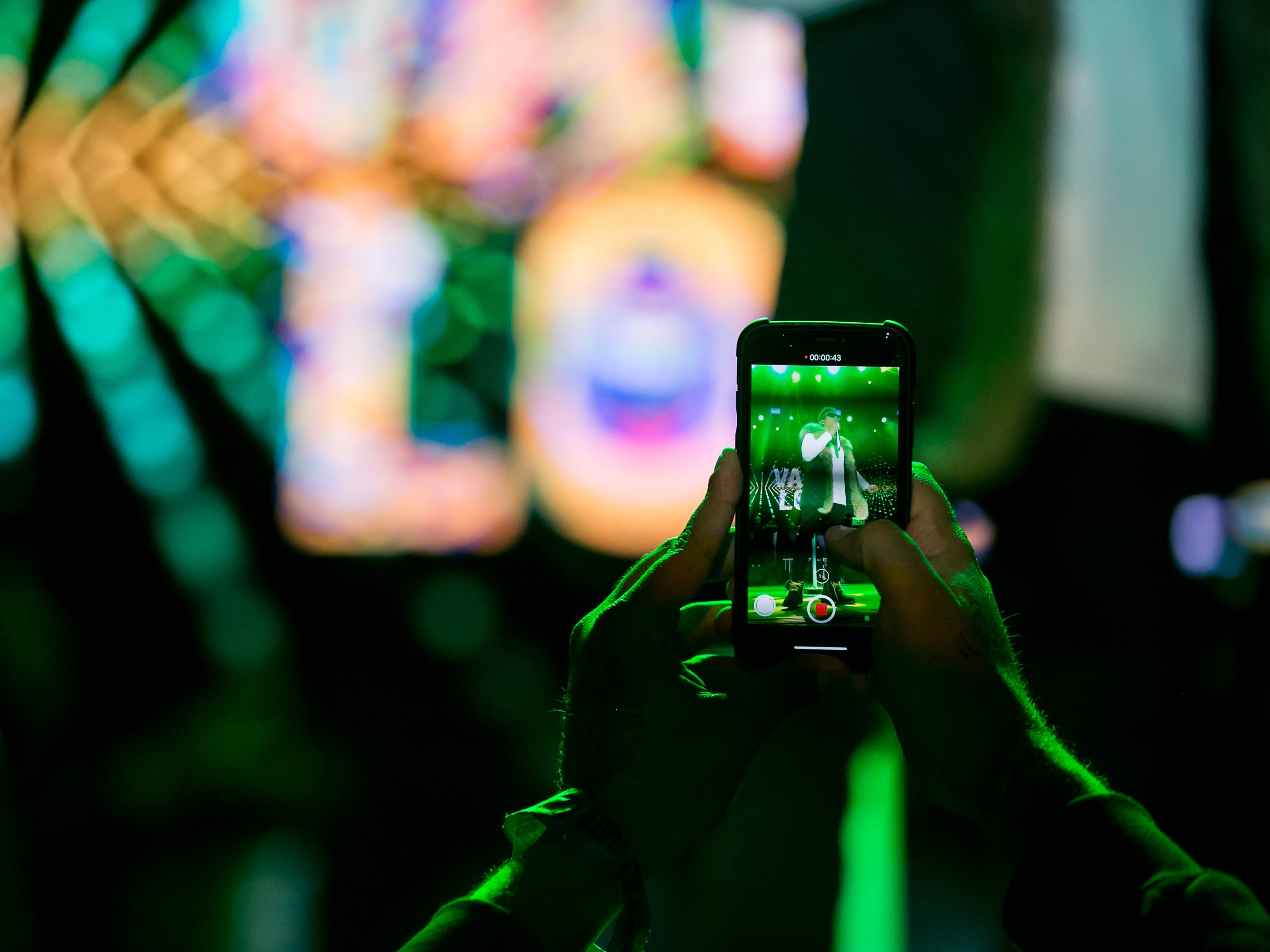A fan takes video of OZUNA at Pot of Gold Music Festival at Steele Indian School Park on Friday, March 15, 2019.