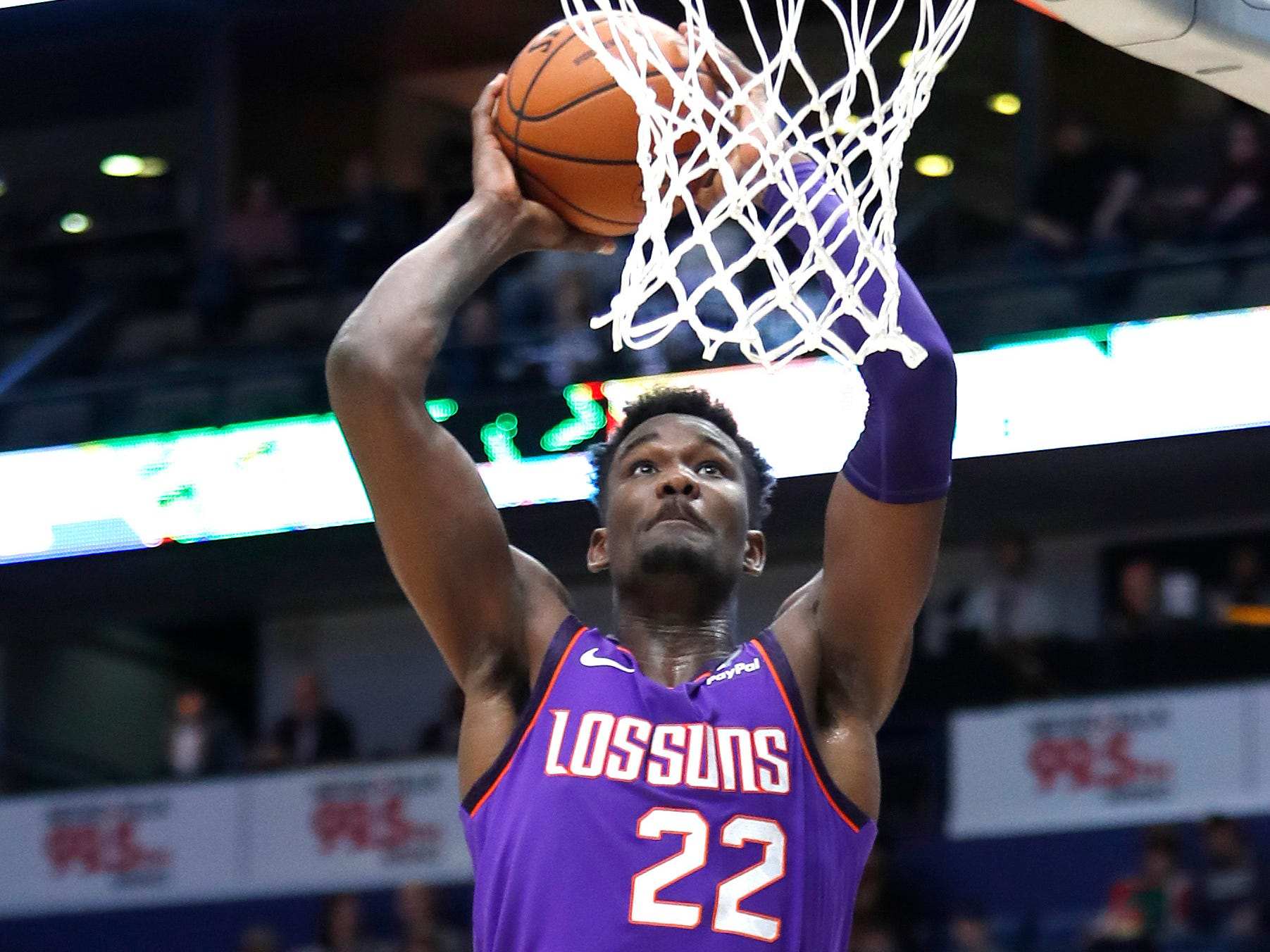 Phoenix Suns center Deandre Ayton (22) dunks the ball during the first half of an NBA basketball game against the New Orleans Pelicans in New Orleans, Saturday, March 16, 2019.