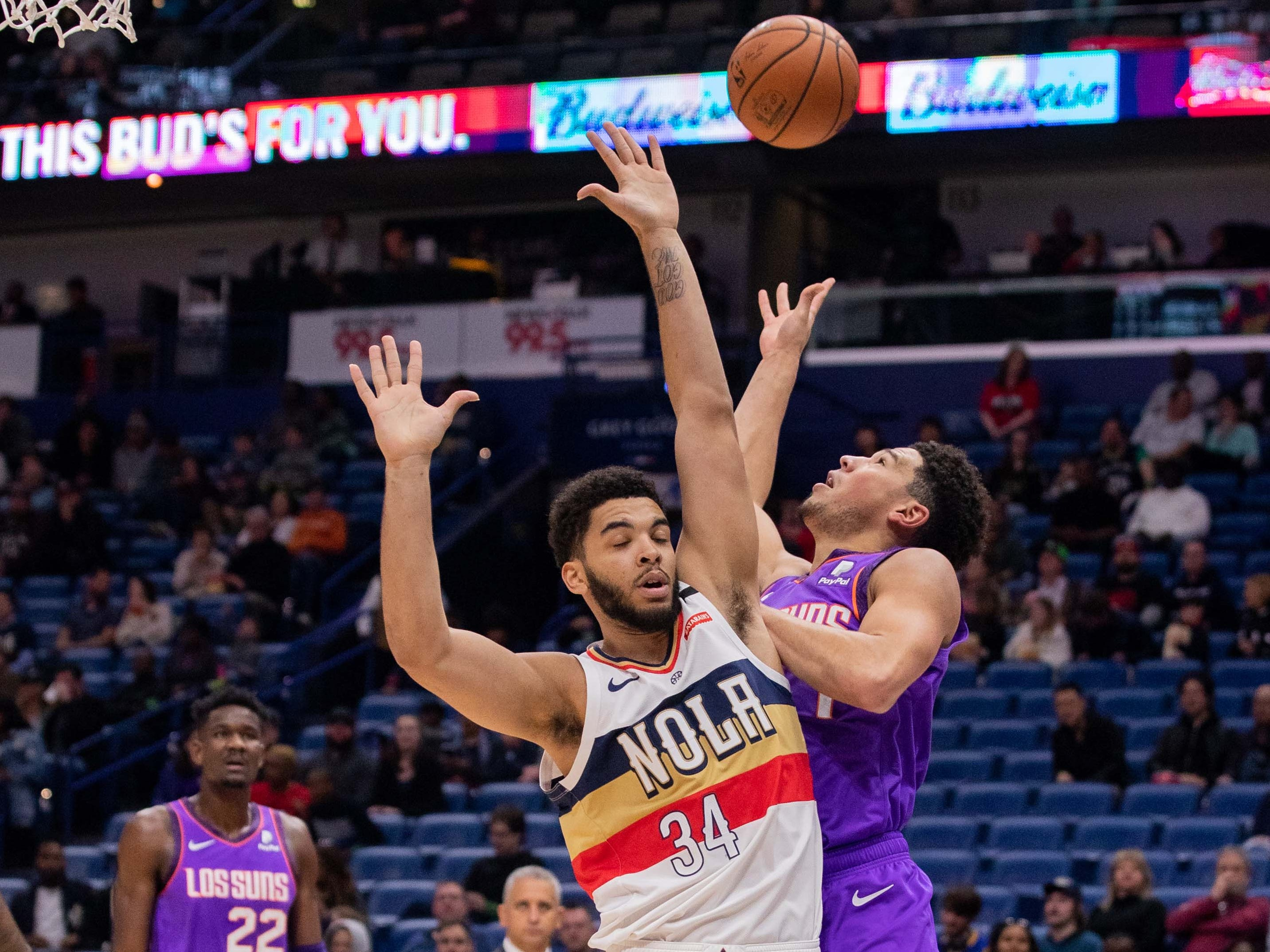 Mar 16, 2019; New Orleans, LA, USA; Phoenix Suns guard Devin Booker (1) drives to the basket against New Orleans Pelicans guard Kenrich Williams (34) during the first half at Smoothie King Center.