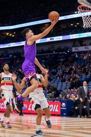 Mar 16, 2019; New Orleans, LA, USA; Phoenix Suns guard Devin Booker (1) drives to the basket against New Orleans Pelicans during the first half at Smoothie King Center.