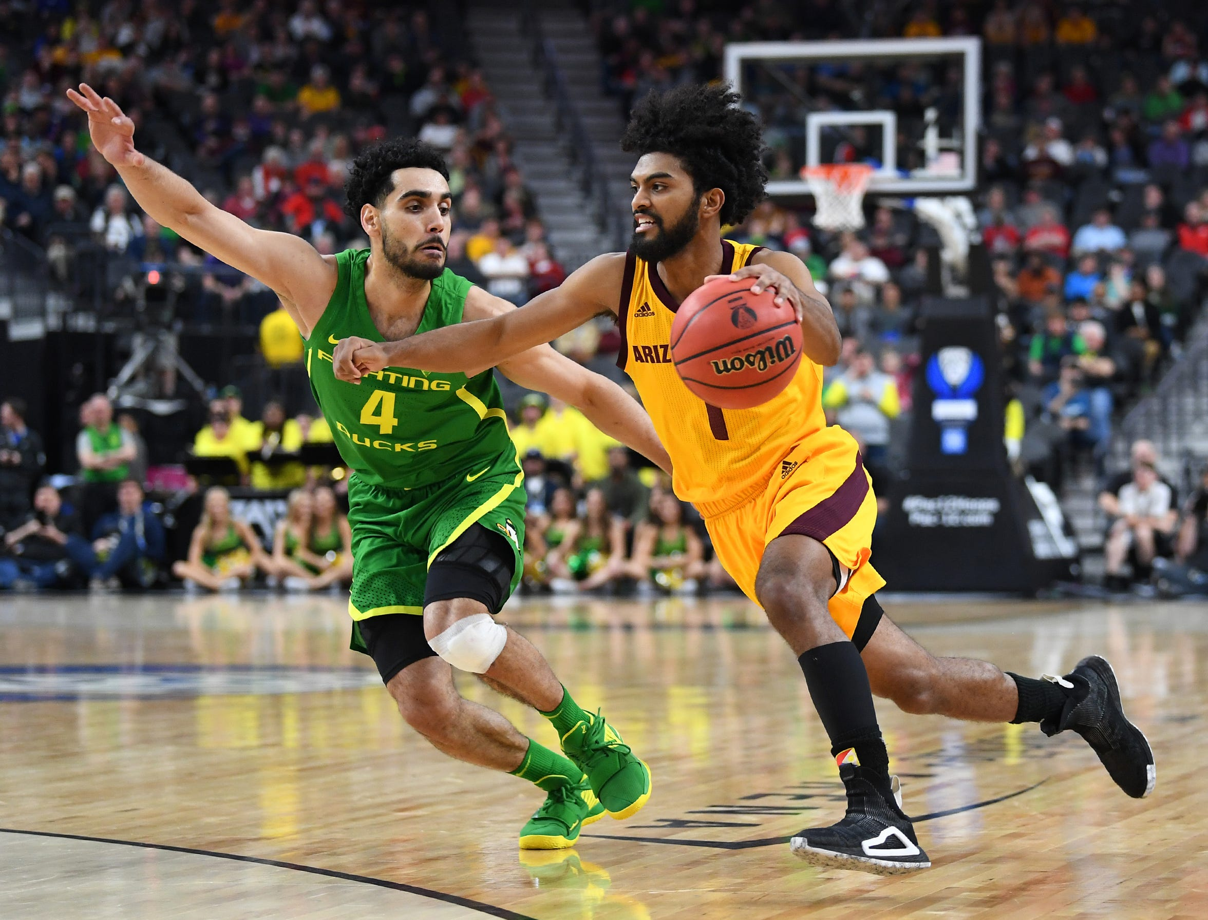 Mar 15, 2019; Las Vegas, NV, United States; Arizona State Sun Devils guard Remy Martin (1) dribbles against Oregon Ducks guard Ehab Amin (4) during the second half of a Pac-12 conference tournament game at T-Mobile Arena. Mandatory Credit: Stephen R. Sylvanie-USA TODAY Sports