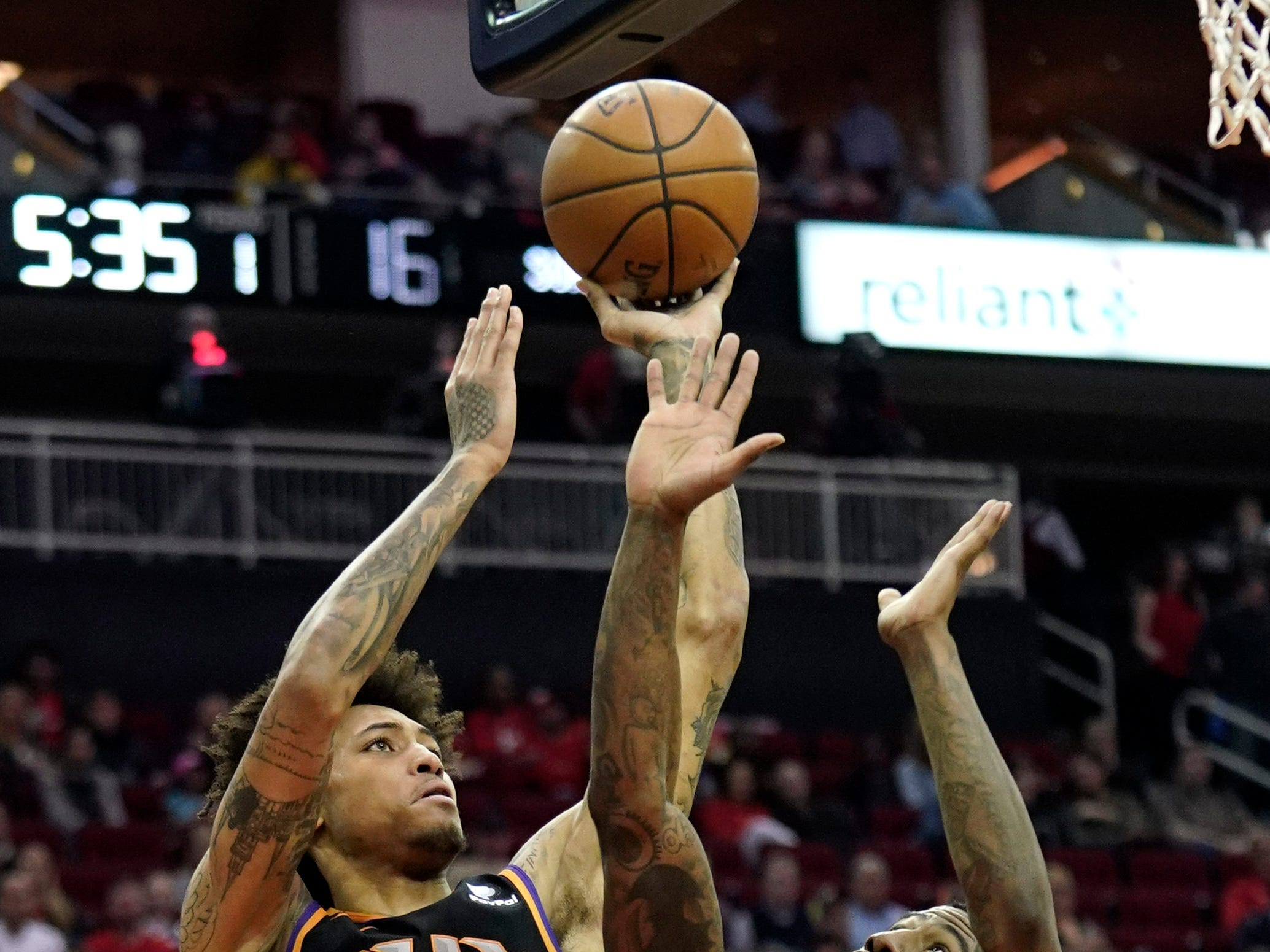 Phoenix Suns' Kelly Oubre Jr. (3) shoots as Houston Rockets' Iman Shumpert (1) defends during the first half of an NBA basketball game Friday, March 15, 2019, in Houston. (AP Photo/David J. Phillip)