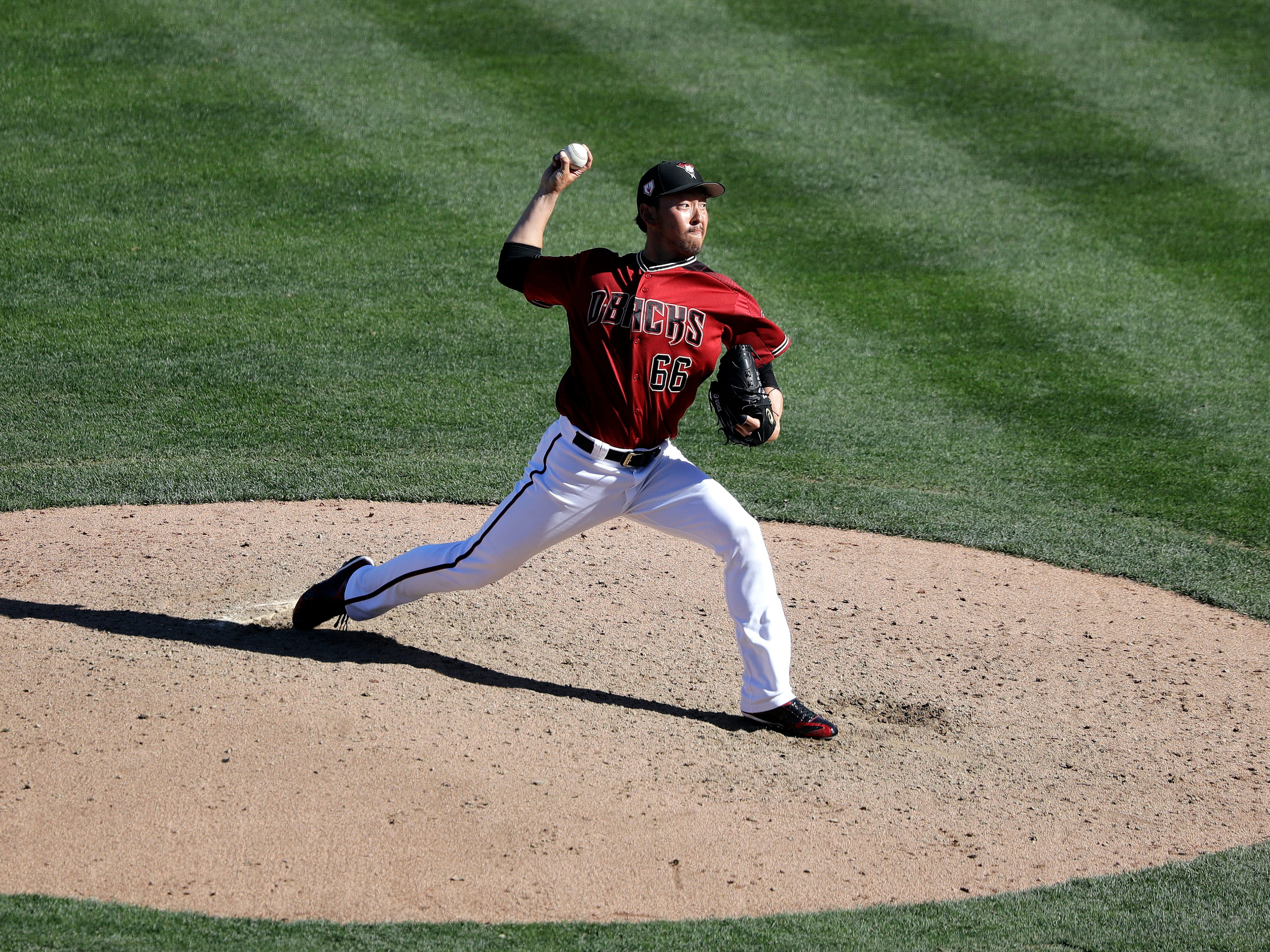 Arizona Diamondbacks relief pitcher Yoshihisa Hirano throws against the Chicago Cubs in the eighth inning of a spring training baseball game Saturday, March 16, 2019, in Scottsdale, Ariz.