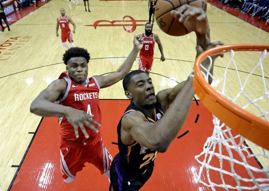 Phoenix Suns' Josh Jackson, right, is fouled by Houston Rockets' Danuel House Jr. (4) during the second half of an NBA basketball game Friday, March 15, 2019, in Houston. The Rockets won 108-102. (AP Photo/David J. Phillip)
