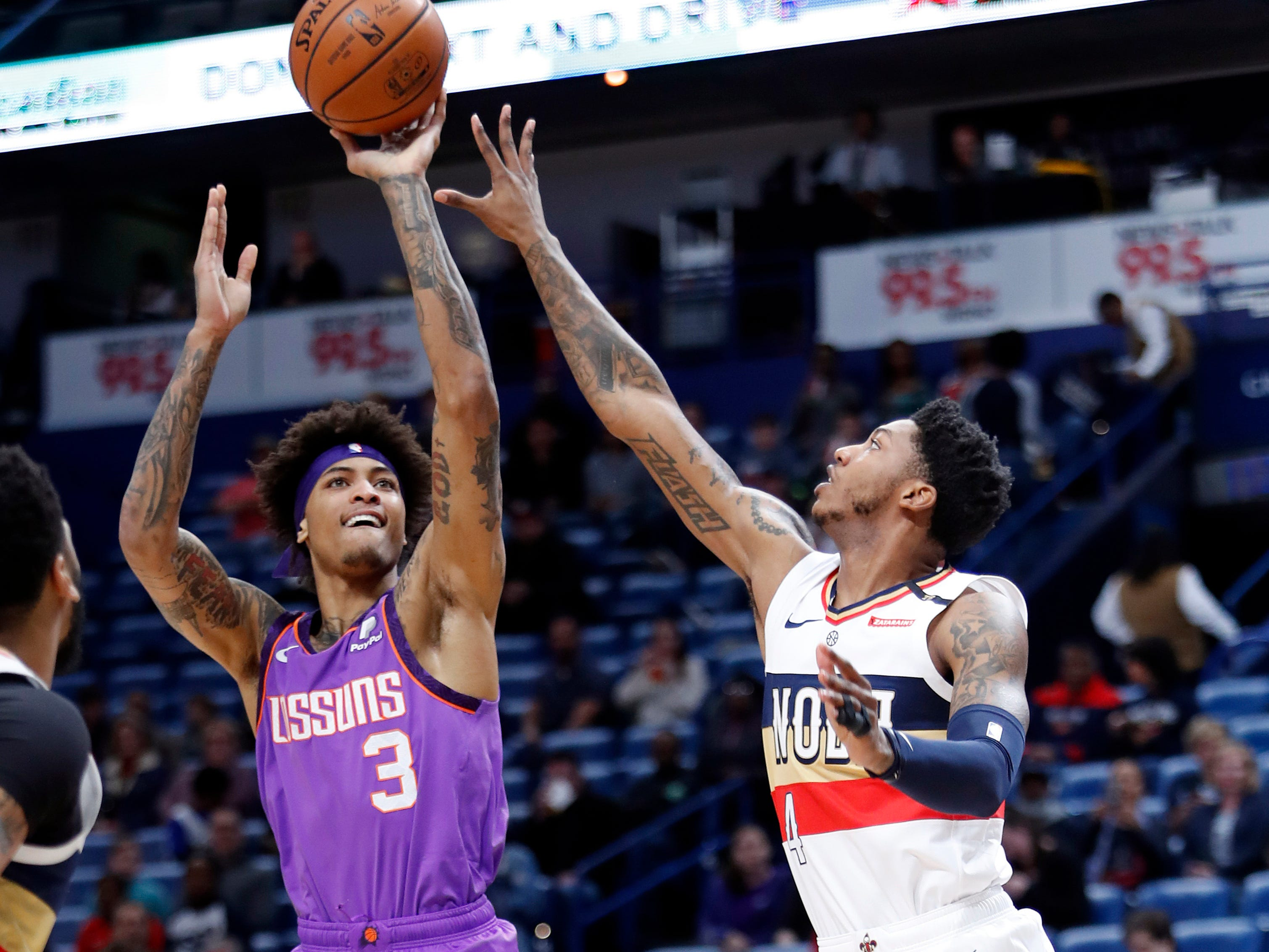 Phoenix Suns forward Kelly Oubre Jr. (3) shoots over New Orleans Pelicans guard Elfrid Payton (4) during the first half of an NBA basketball game in New Orleans, Saturday, March 16, 2019.