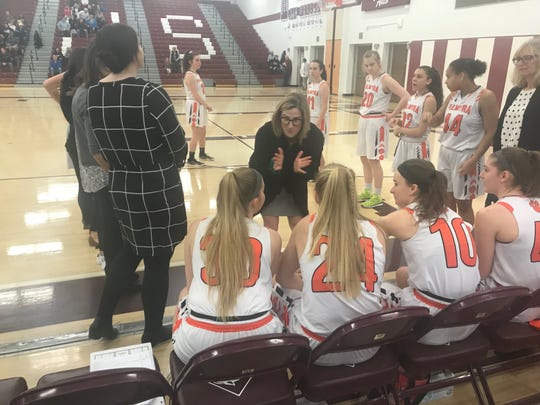 Palmyra girls basketball coach Mary Manlove speaks to her team prior to Saturday's state quarterfinal loss to Thomas Jefferson.