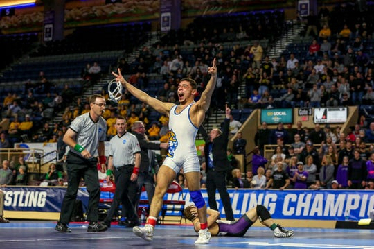 Jay Albis celebrates his second NCAA Division III wrestling title.