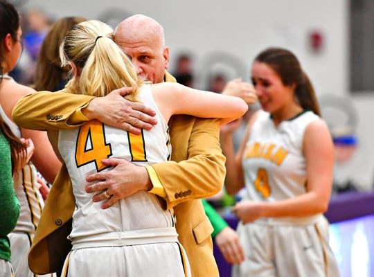 York Catholic's Head Coach Kevin Bankos embraces Elena Kondrasuk following PIAA girls' Class 2-A basketball quarterfinal game against Bellwood Antis at Mifflin County High School in Lewistown, Friday, March 15, 2019. Bellwood Antis would win the game 53-47. Dawn J. Sagert photo