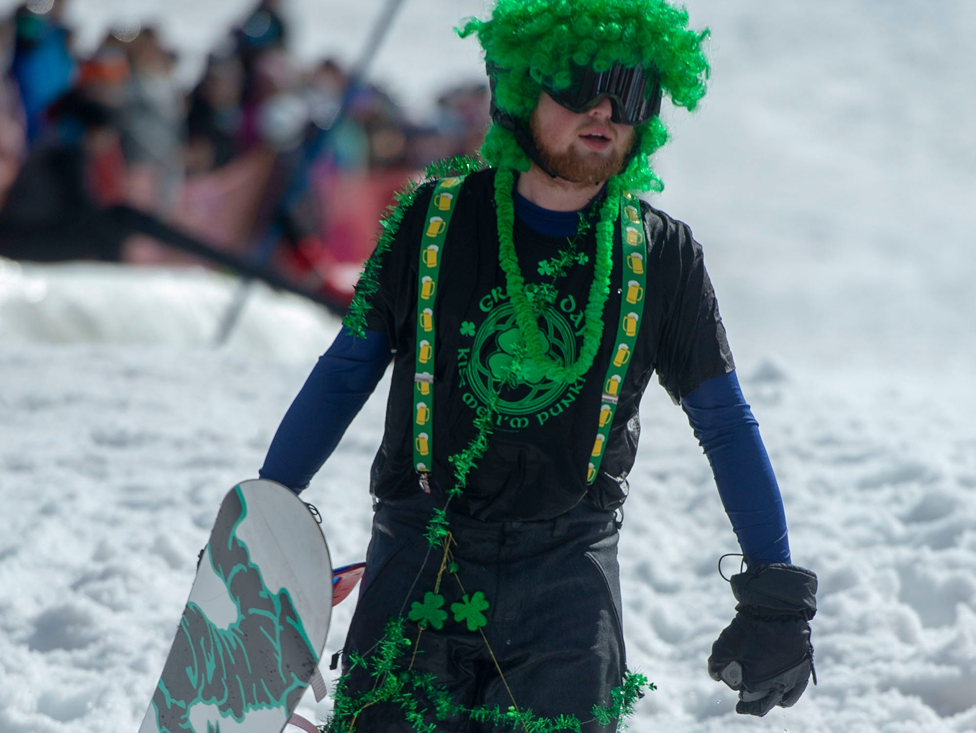 Throwing on some St. Patrick's Day decorations made for an easy costume at pond skimming at Roundtop Mountain Resort on Saturday, March 16, 2019.