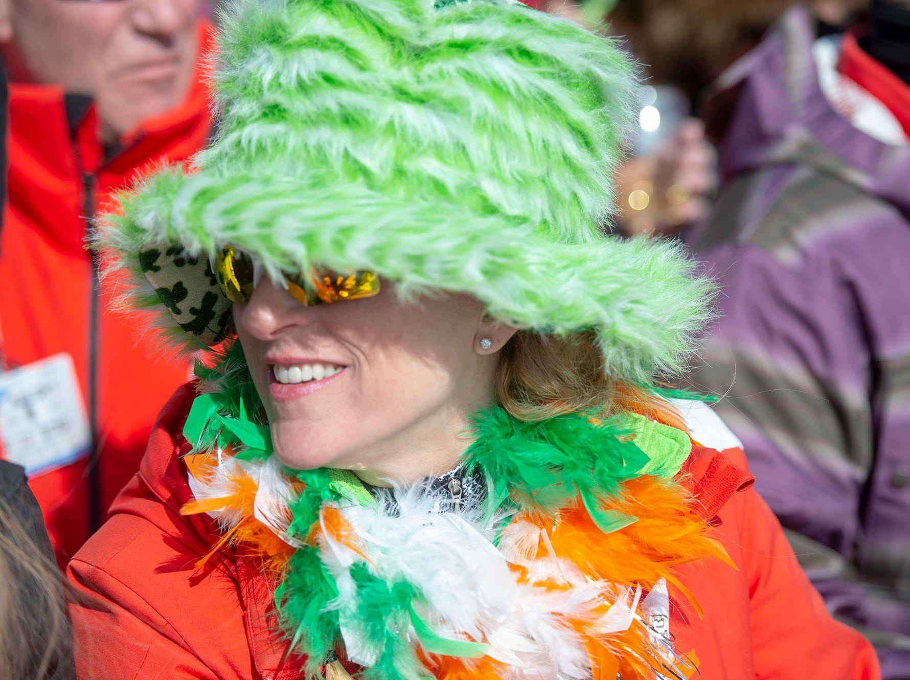 Rebecca Hornung of Linglestown dressed for warmth and St. Patrick's Day as she watched pond skimming at Roundtop Mountain Resort on Saturday, March 16, 2019.
