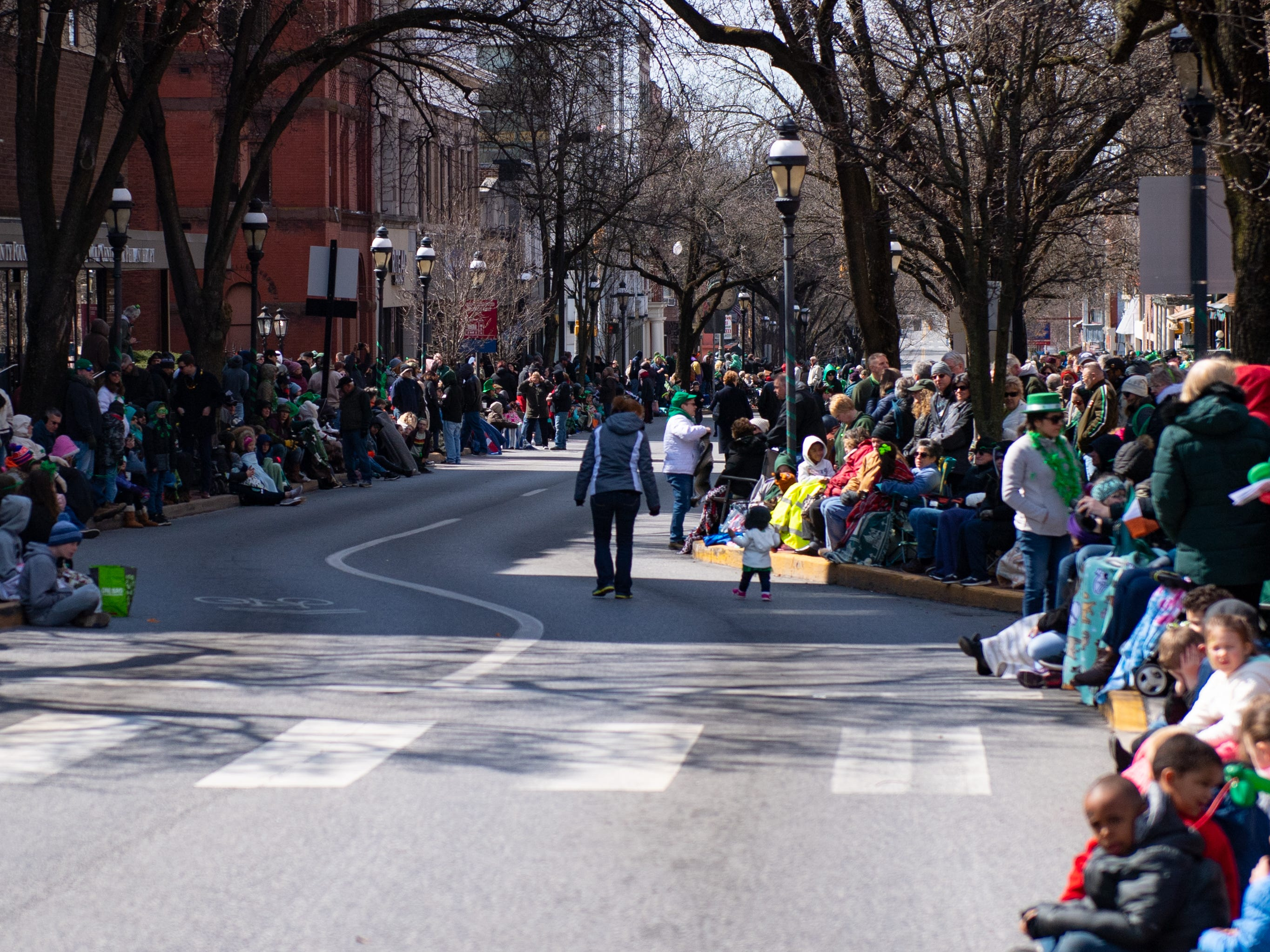 Yorkers wait for the St. Patrick's Day Parade to come through, March 16, 2019.