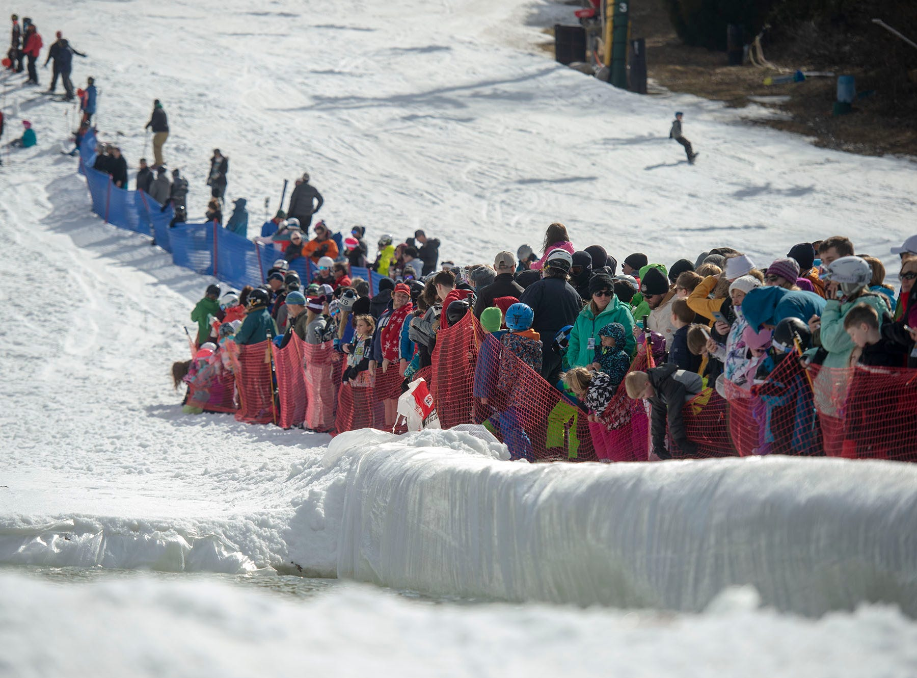 Hundreds of spectators lined both sides of the pond skimming run at Roundtop Mountain Resort on Saturday, March 16, 2019.
