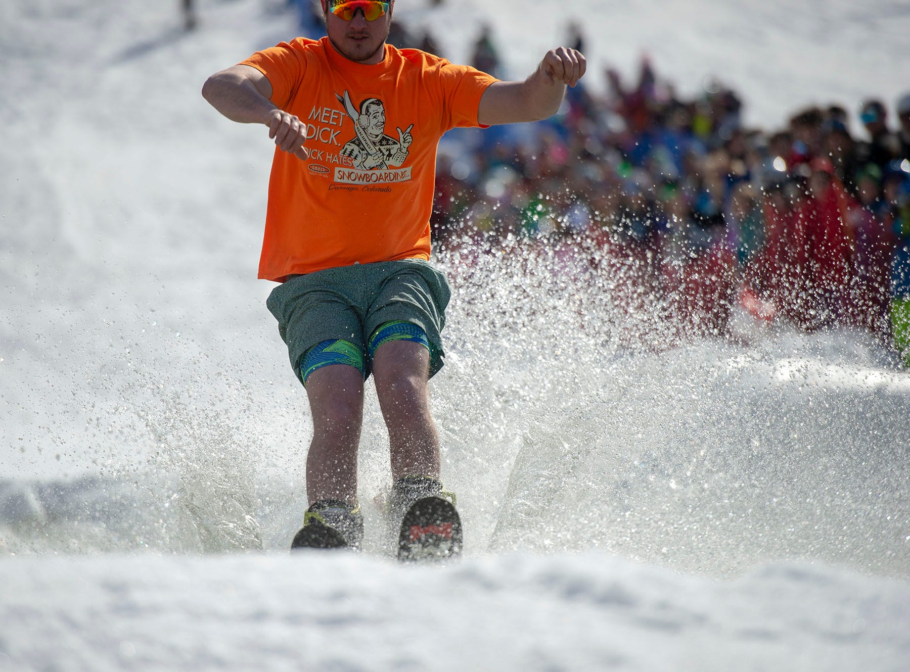 This participant makes pond skimming look easy ... and warm ... at Roundtop Mountain Resort on Saturday, March 16, 2019.
