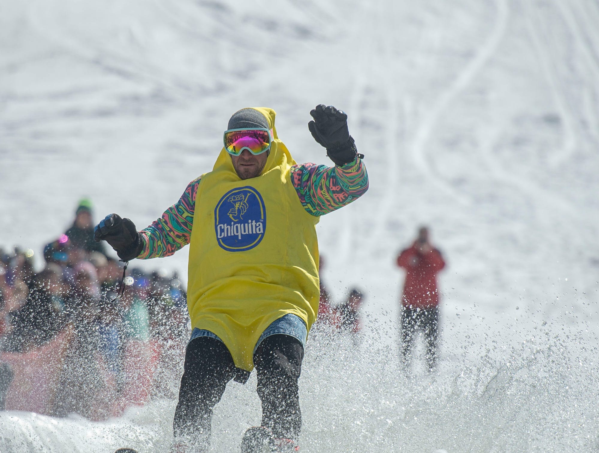 A participant wears a banana costume to successfully skim the pond at Roundtop Mountain Resort on Saturday, March 16, 2019.