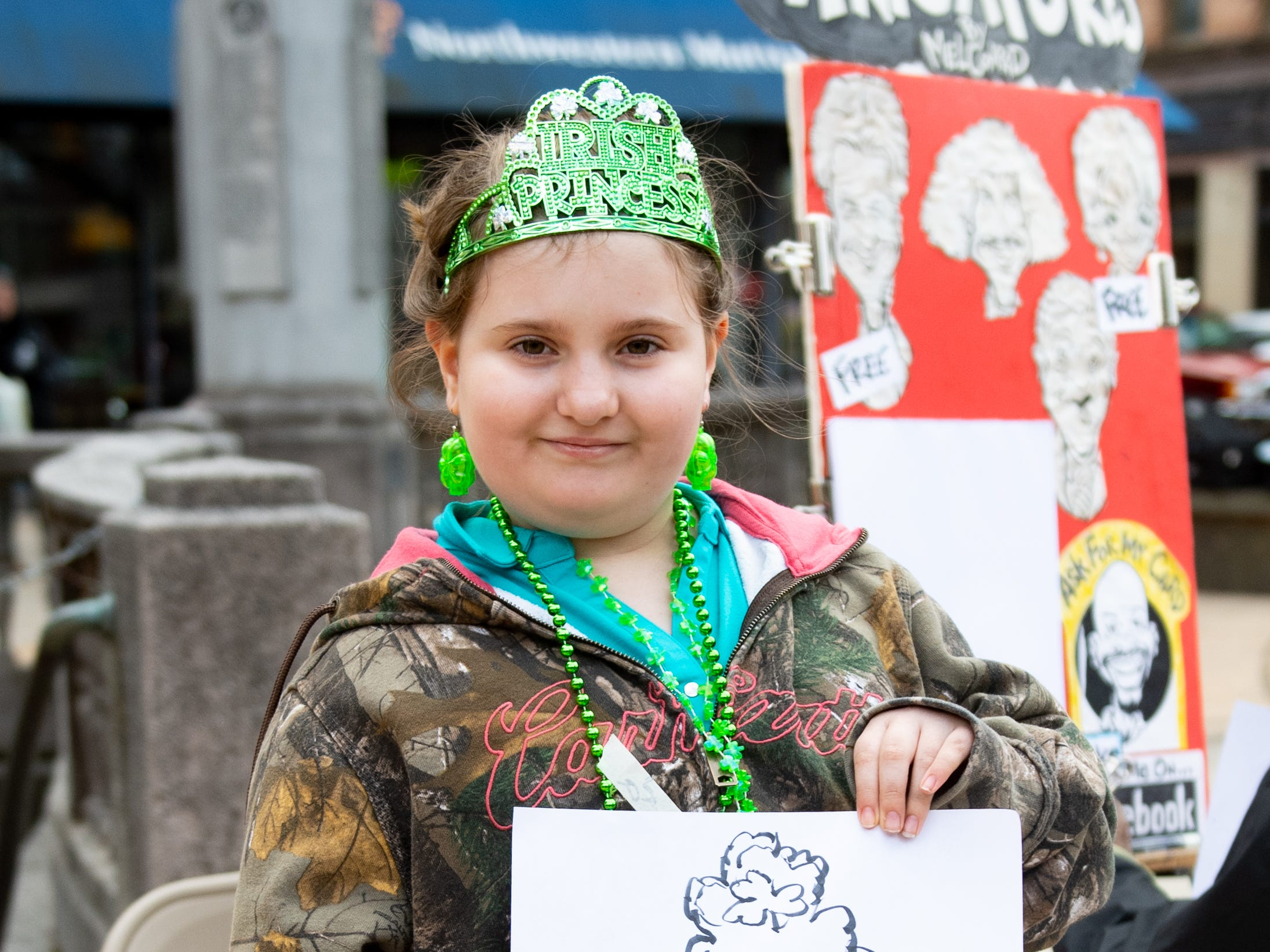 Jaylee Biller of Manchester Township is proud of her caricature during the St. Patrick's Day Parade, March 16, 2019.