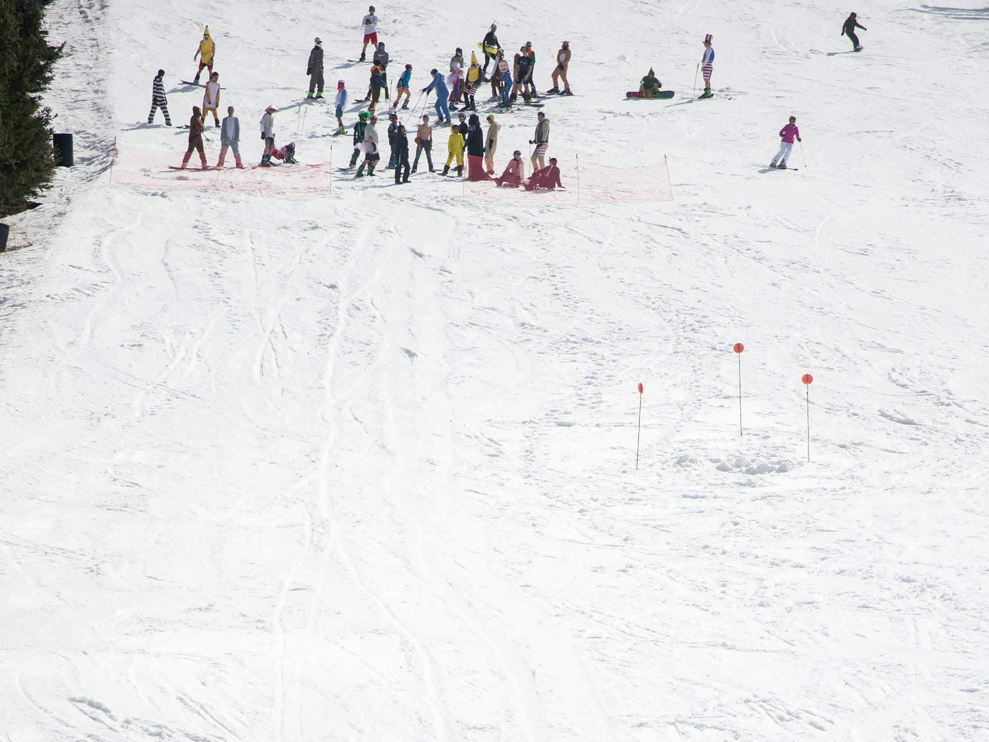 Costumed snowboarders and skiers took off from the midway point on the Minuteman Run at Roundtop Mountain Resort and tried to skim across an approximately 80-foot long pond (foreground) on Saturday, March 16, 2019.
