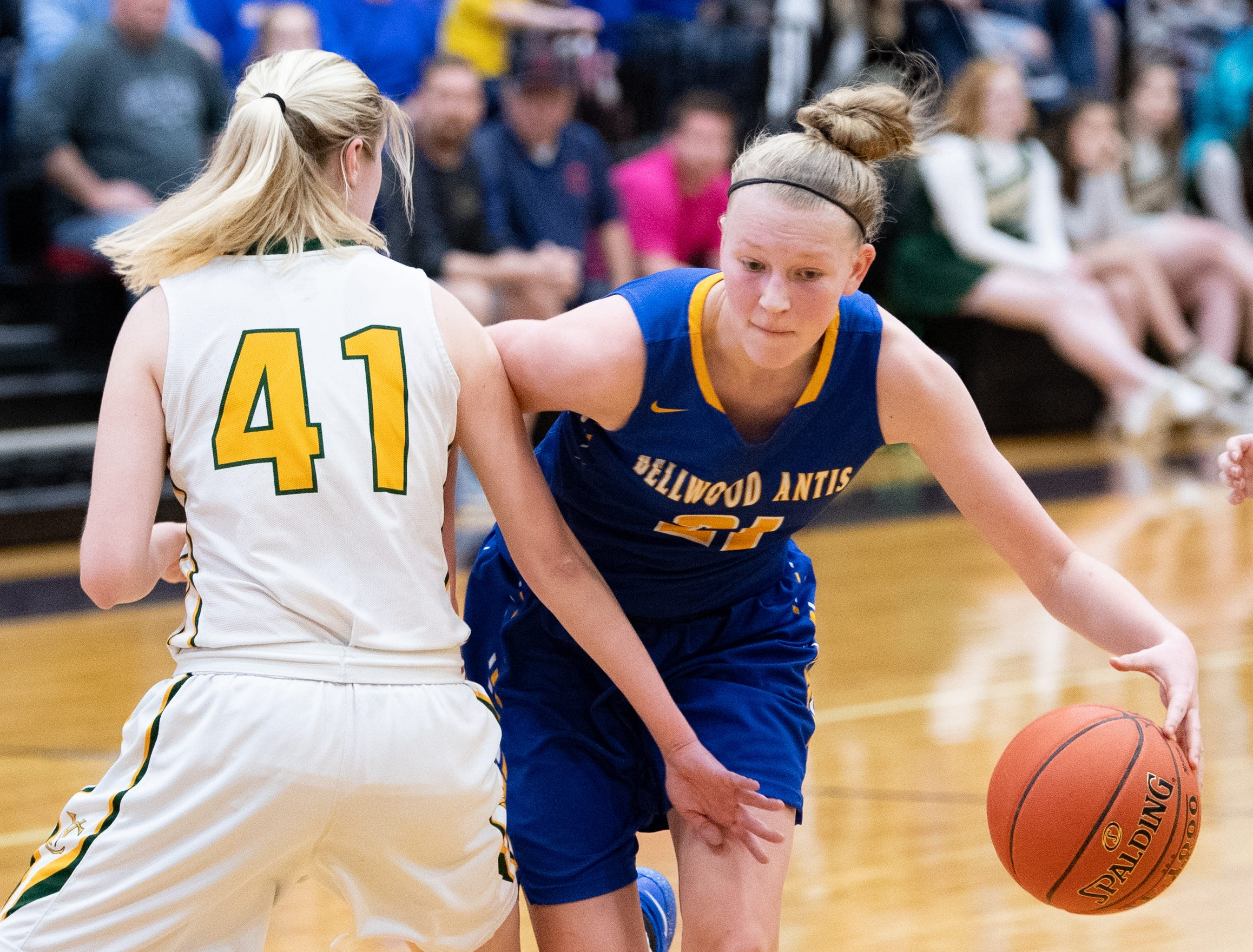 Alli Campbell (21) tries to get past the defense during the PIAA girls' basketball game between York Catholic and Bellwood-Antis, March 15, 2019 at Mifflin County High School. The Fighting Irish lost to the Lady Blue Devils 53 to 47.