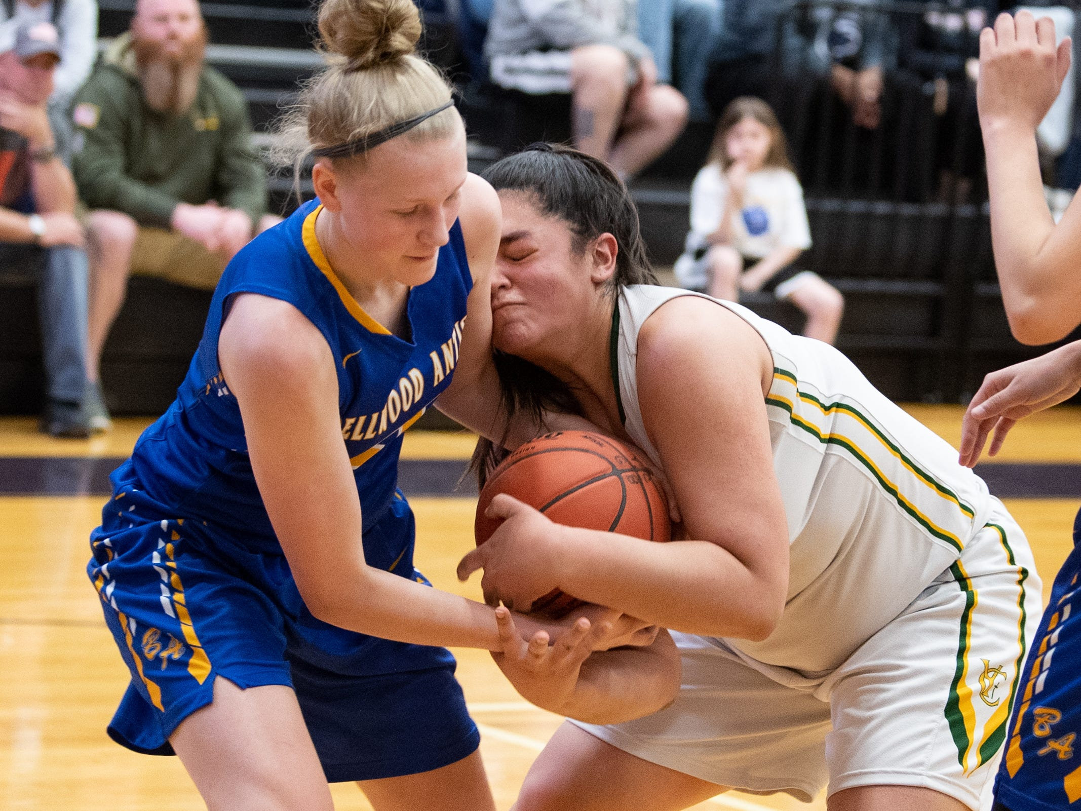 Alli Campbell (21) of Bellwood-Antis and Gabby Coley (11) of York Catholic wrestle for the ball during the PIAA girls' basketball game between York Catholic and Bellwood-Antis, March 15, 2019 at Mifflin County High School. The Fighting Irish lost to the Lady Blue Devils 53 to 47.