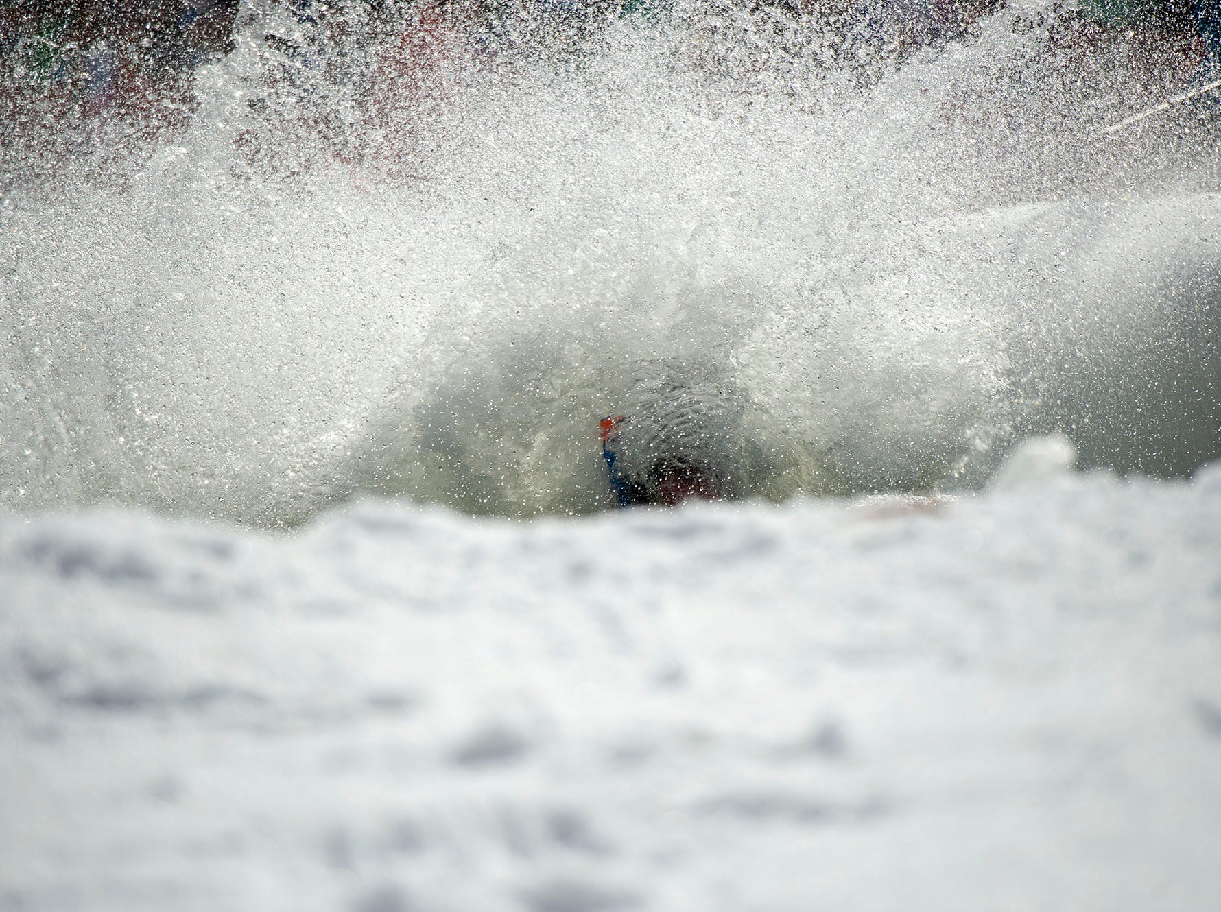 All that can be seen of this participant is his snorkel at the end of his pond skimming run at Roundtop Mountain Resort on Saturday, March 16, 2019.