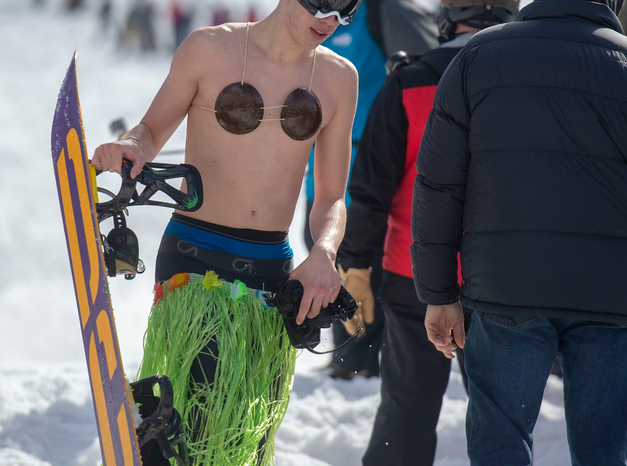 Some costumes at Roundtop Mountain Resort's pond skimming on Saturday, March 16, 2019, were better suited to surfing than snowboarding.