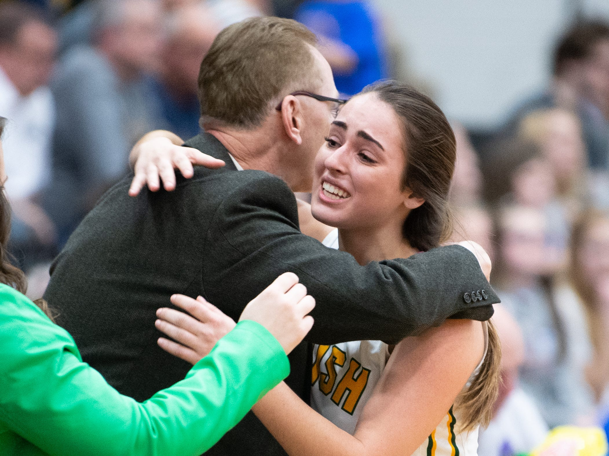 Gina Citrone (4) hugs a York Catholic assistant coach after the PIAA girls' basketball game between York Catholic and Bellwood-Antis, March 15, 2019 at Mifflin County High School. The Fighting Irish lost to the Lady Blue Devils 53 to 47.