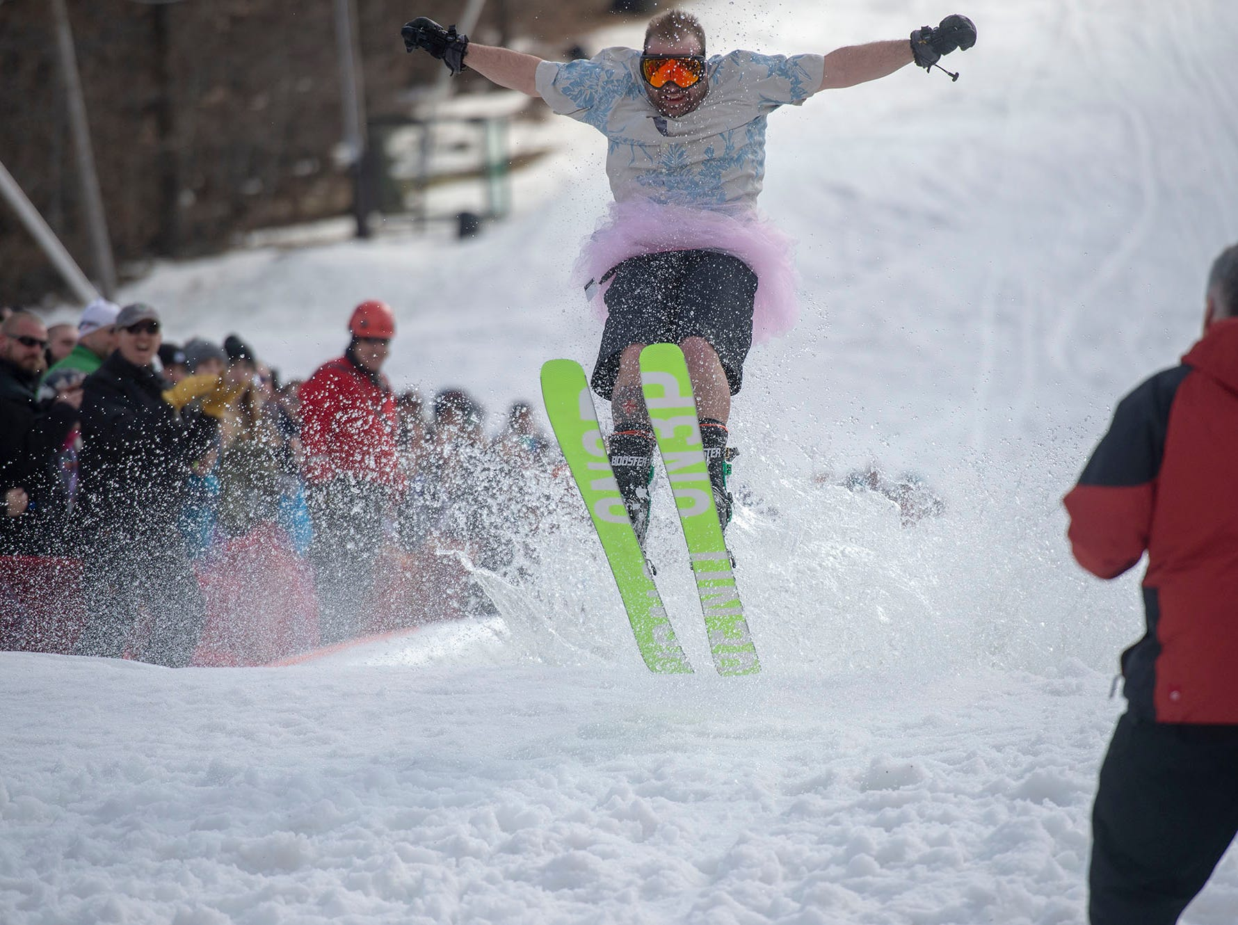 Spectators cheer as the first participant gets air while exiting the pond at Roundtop Mountain Resort on Saturday, March 16, 2019.