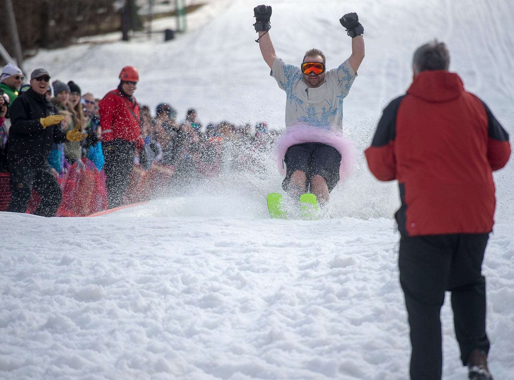 A man in a pink tutu celebrates being the first participant to skim the pond at Roundtop Mountain Resort on Saturday, March 16, 2019.