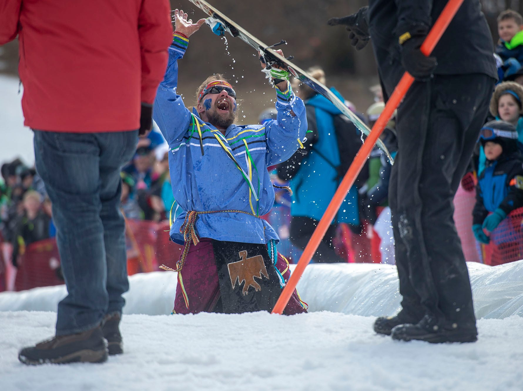 A participant wearing Native American garb shows that is OK after crashing and burning in the pond at Roundtop Moutain Resort on Saturday, March 16, 2019.