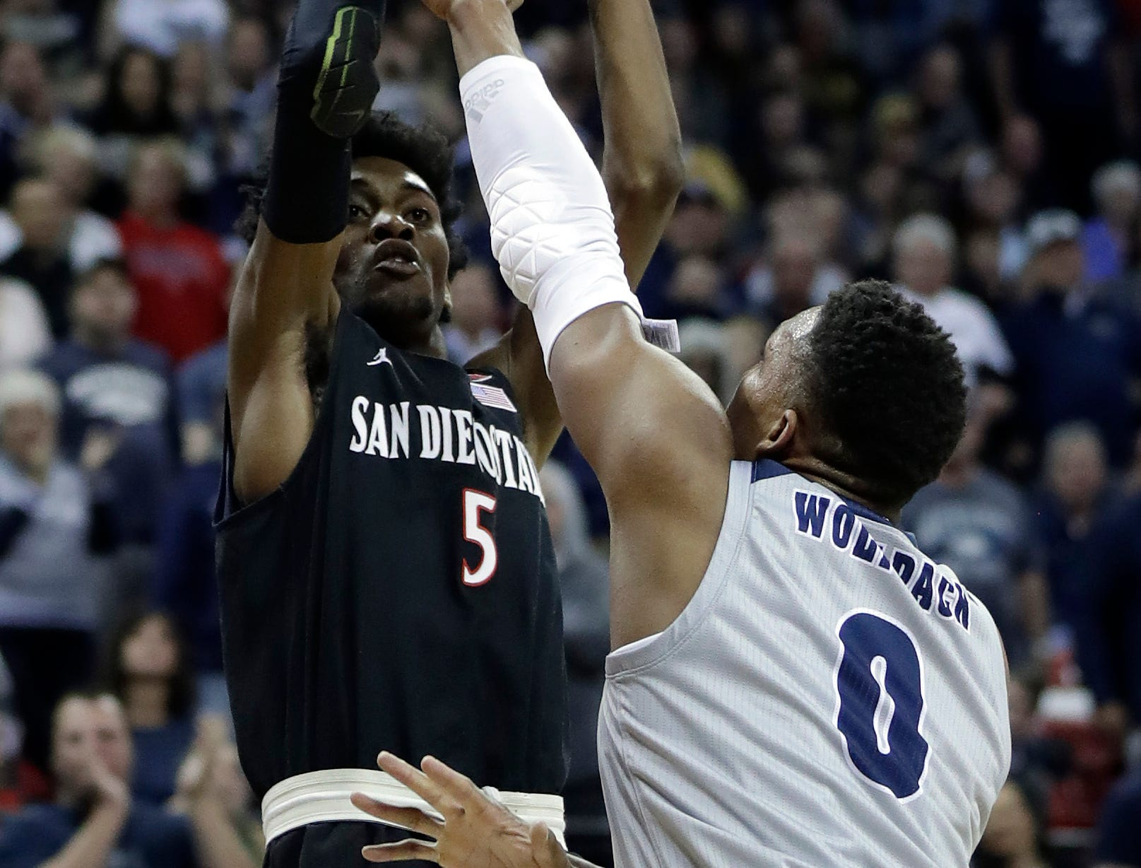 San Diego State's Jalen McDaniels shoots as Nevada's Tre'Shawn Thurman defends during the second half of an NCAA college basketball game in the Mountain West Conference men's tournament Friday, March 15, 2019, in Las Vegas. (AP Photo/Isaac Brekken)