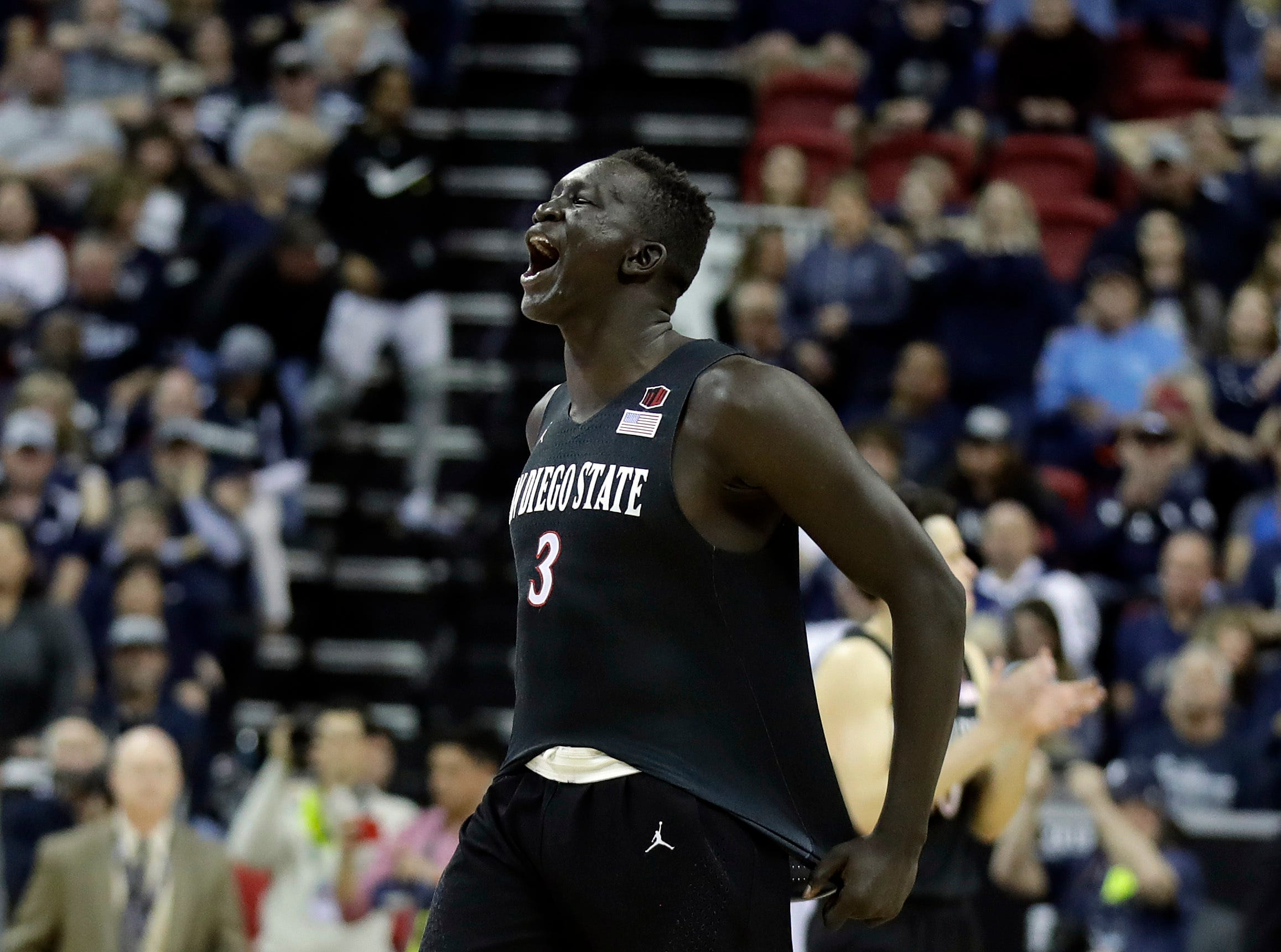 San Diego State's Aguek Arop reacts at the final buzzer of the team's NCAA college basketball game against Nevada in the Mountain West Conference men's tournament Friday, March 15, 2019, in Las Vegas. (AP Photo/Isaac Brekken)