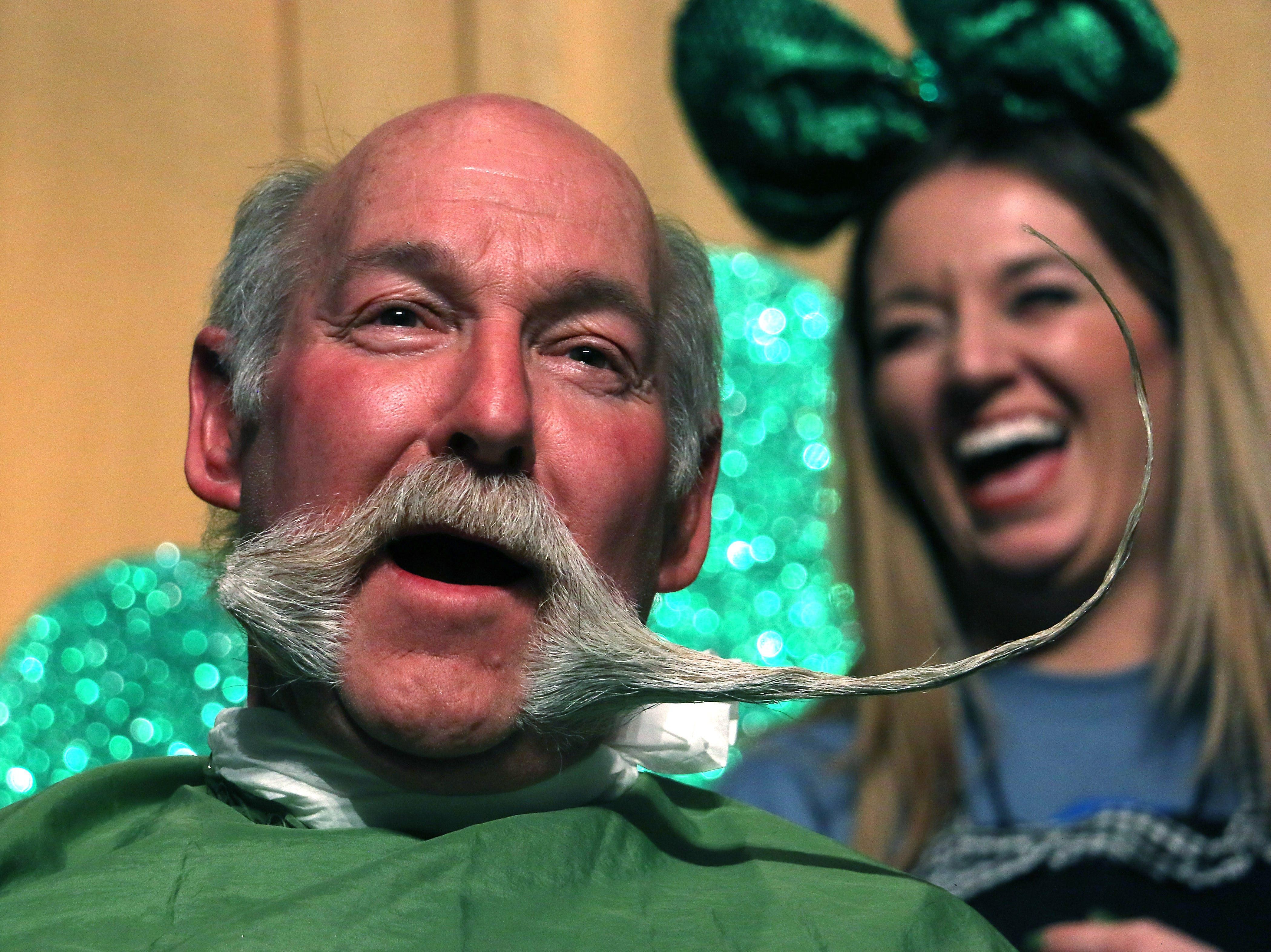 A participant gets his impressive mustache cut off during the Northern Nevada Children Cancer Foundation and the St. Baldrick's Foundation's fundraising head-shaving event at the Downtown Reno Ballroom on March 15, 2019.