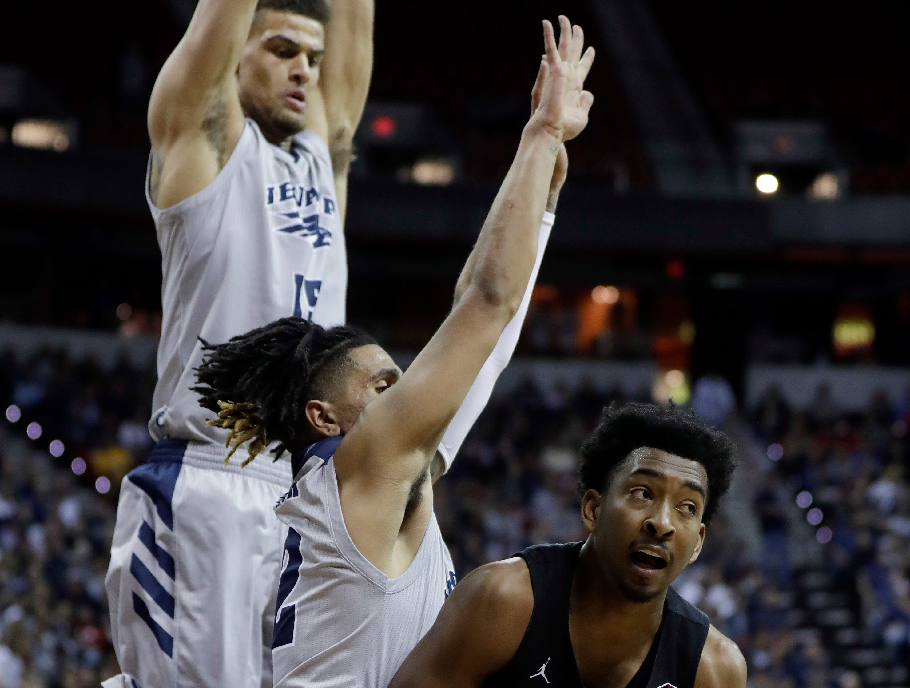 Nevada's Trey Porter (15) and Jazz Johnson (22) defend as San Diego State's Devin Watson looks to pass the ball during the second half of an NCAA college basketball game in the Mountain West Conference men's tournament Friday, March 15, 2019, in Las Vegas. (AP Photo/Isaac Brekken)