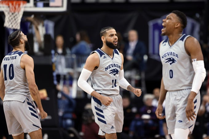 Nevada's Caleb Martin (10, Cody Martin (11) and Tre'Shawn Thurman (0) react after a basket during the second half of the team's NCAA college basketball game against San Diego State in the Mountain West Conference men's tournament Friday, March 15, 2019, in Las Vegas. (AP Photo/Isaac Brekken)