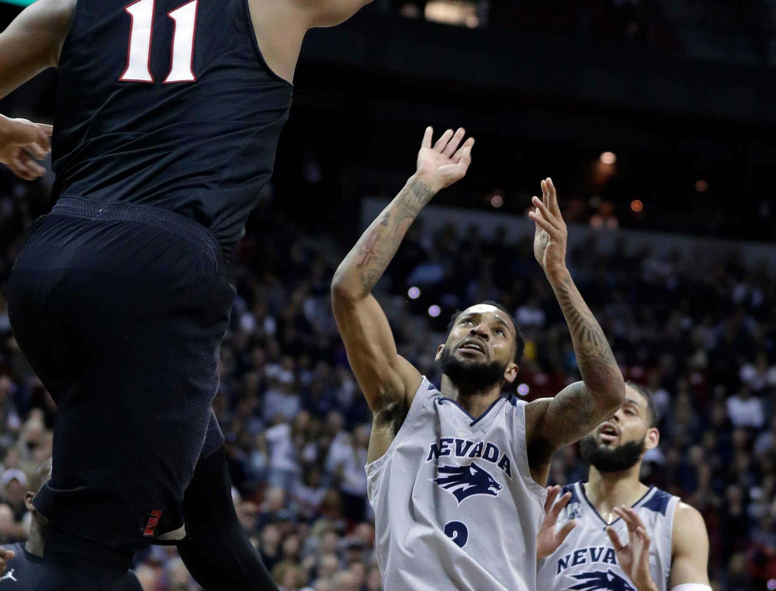 San Diego State's Matt Mitchell (11) defends as Nevada's Corey Henson shoots during the first half of an NCAA college basketball game in the Mountain West Conference men's tournament Friday, March 15, 2019, in Las Vegas. (AP Photo/Isaac Brekken)