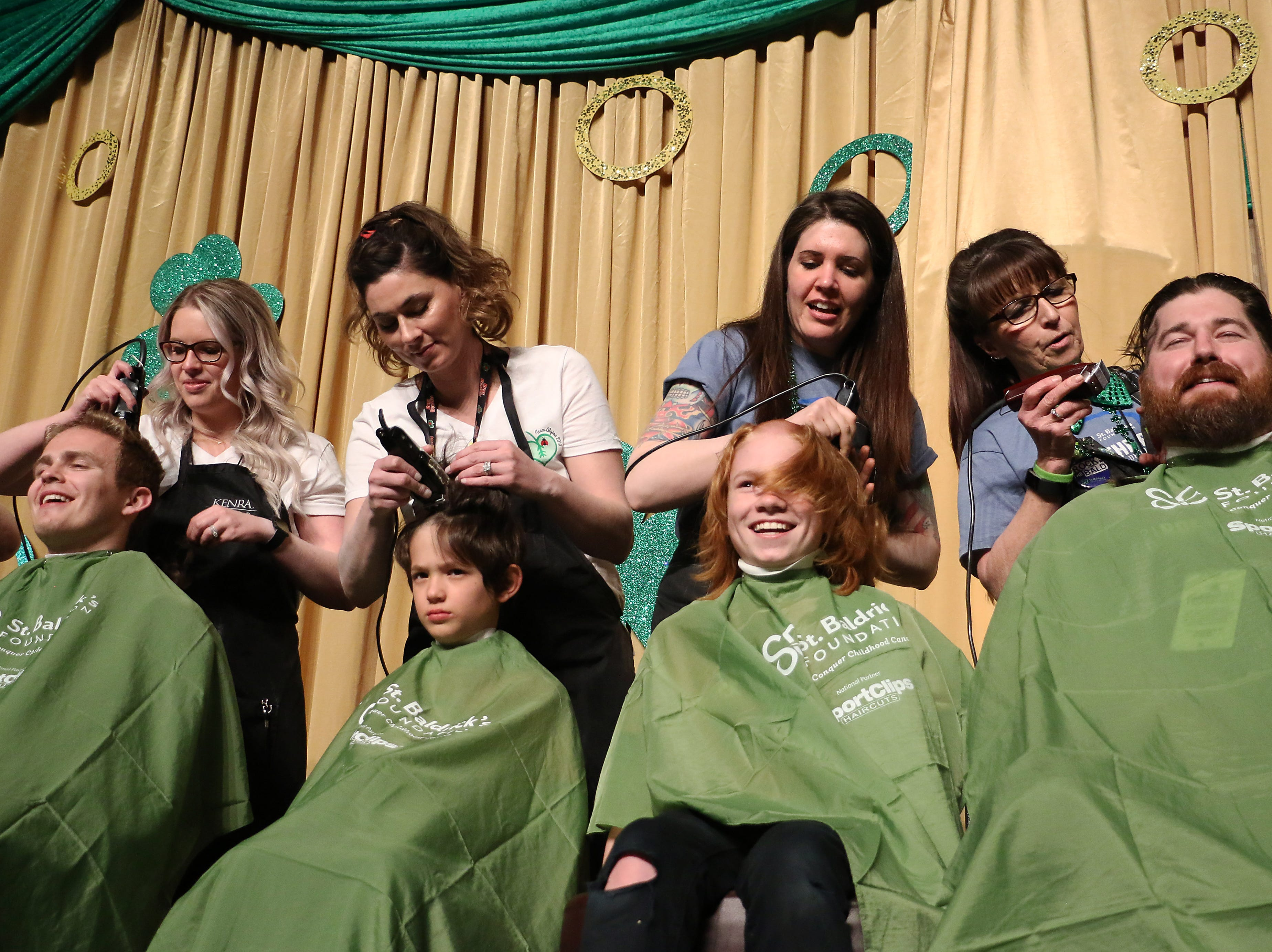 People of all ages participate in the Northern Nevada Children's Cancer Foundation and the St. Baldrick's Foundation's fundraising head-shaving event at the Downtown Reno Ballroom on March 15, 2019.