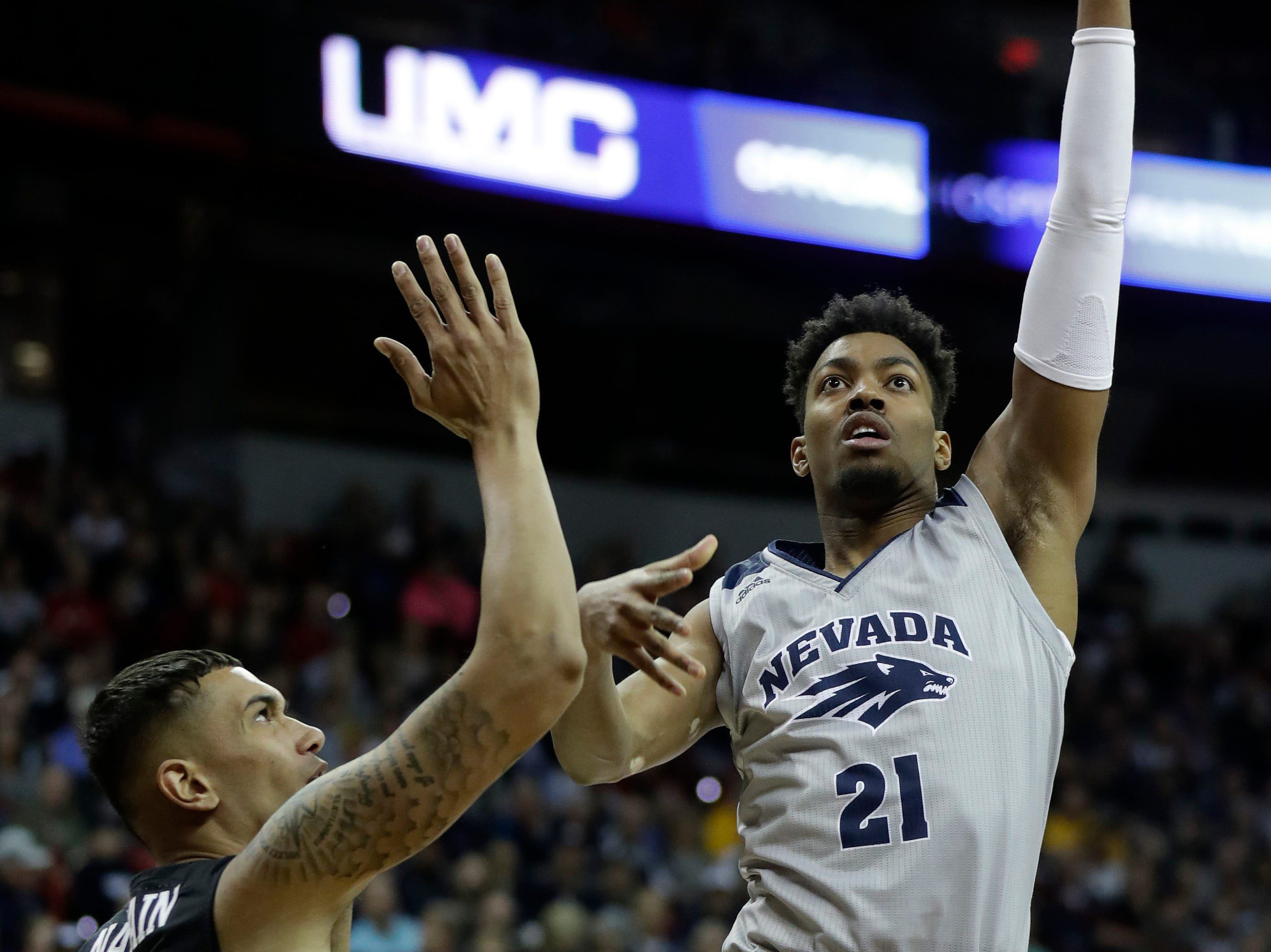 San Diego State's Nolan Narain (24) defends as Nevada's Jordan Brown (21) shoots during the first half of an NCAA college basketball game in the Mountain West Conference men's tournament Friday, March 15, 2019, in Las Vegas. (AP Photo/Isaac Brekken)