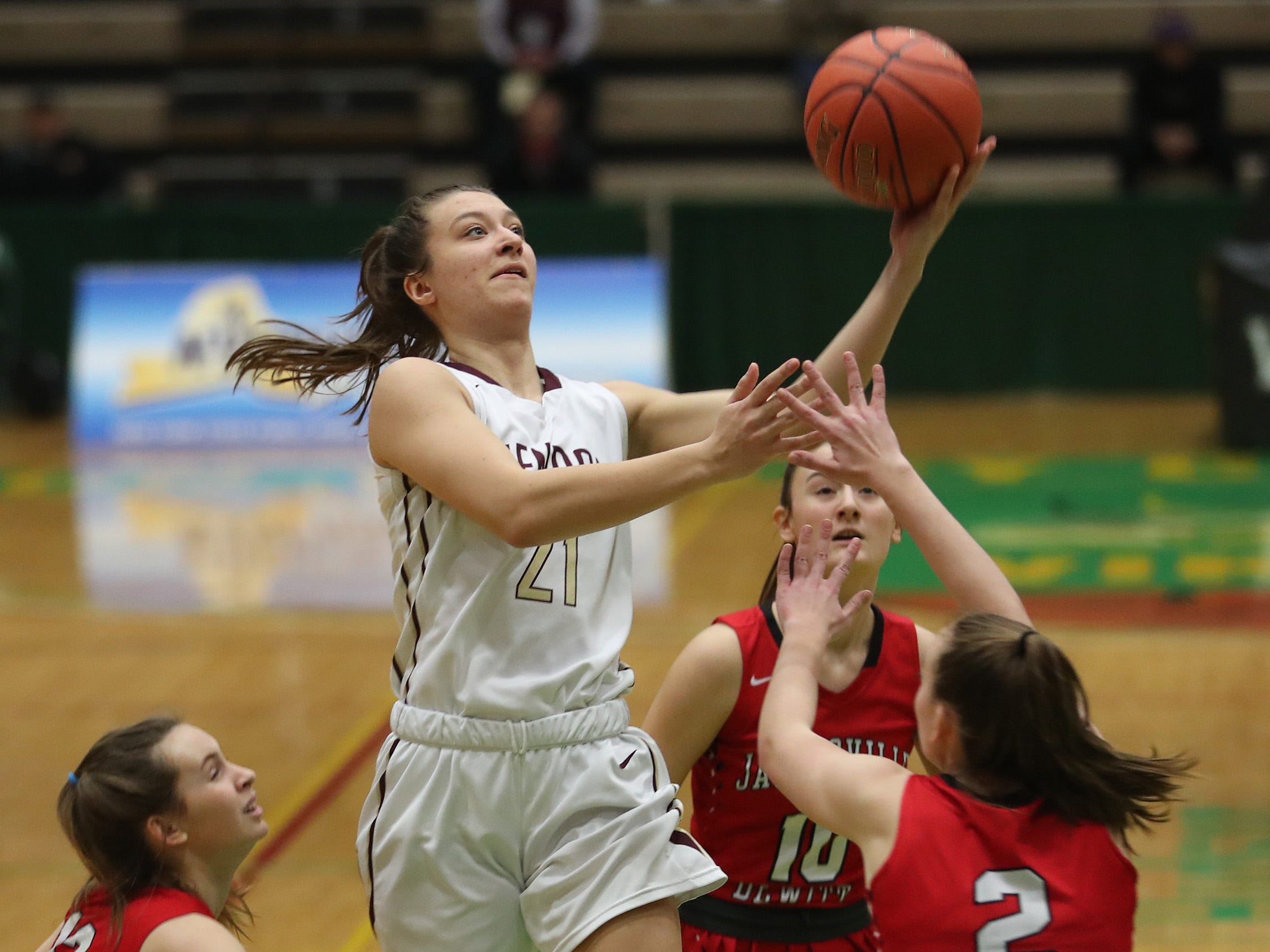 Pittsford Mendon's Alana Fursman (21) drives to the basket against Jamesville-DeWitt during the girls Class A state semifinal at Hudson Valley Community College in Troy March 16, 2019. Mendon won 44-32.