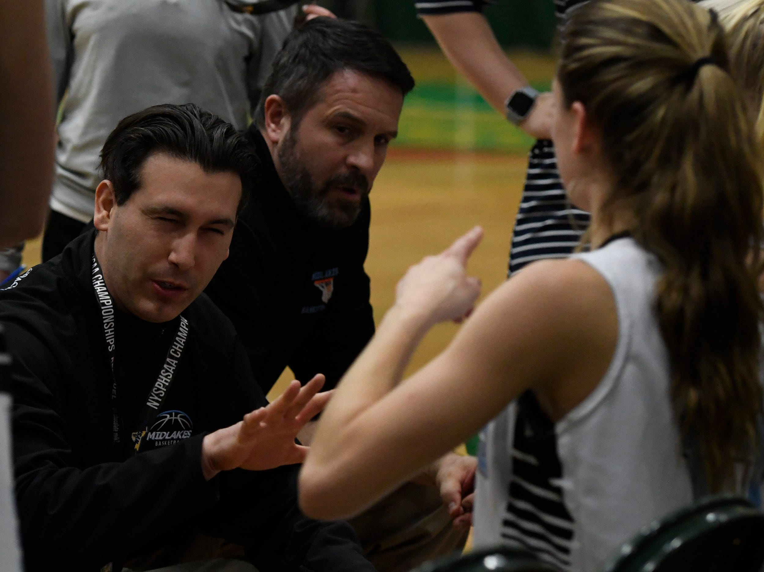 Midlakes head coach Nate Rich jokes with one of his players as she starts dancing between the third and forth quarters of their Class B State Semifinal against Canton at Hudson Valley Community College in Troy, N.Y. on Friday, Mar. 15, 2019.