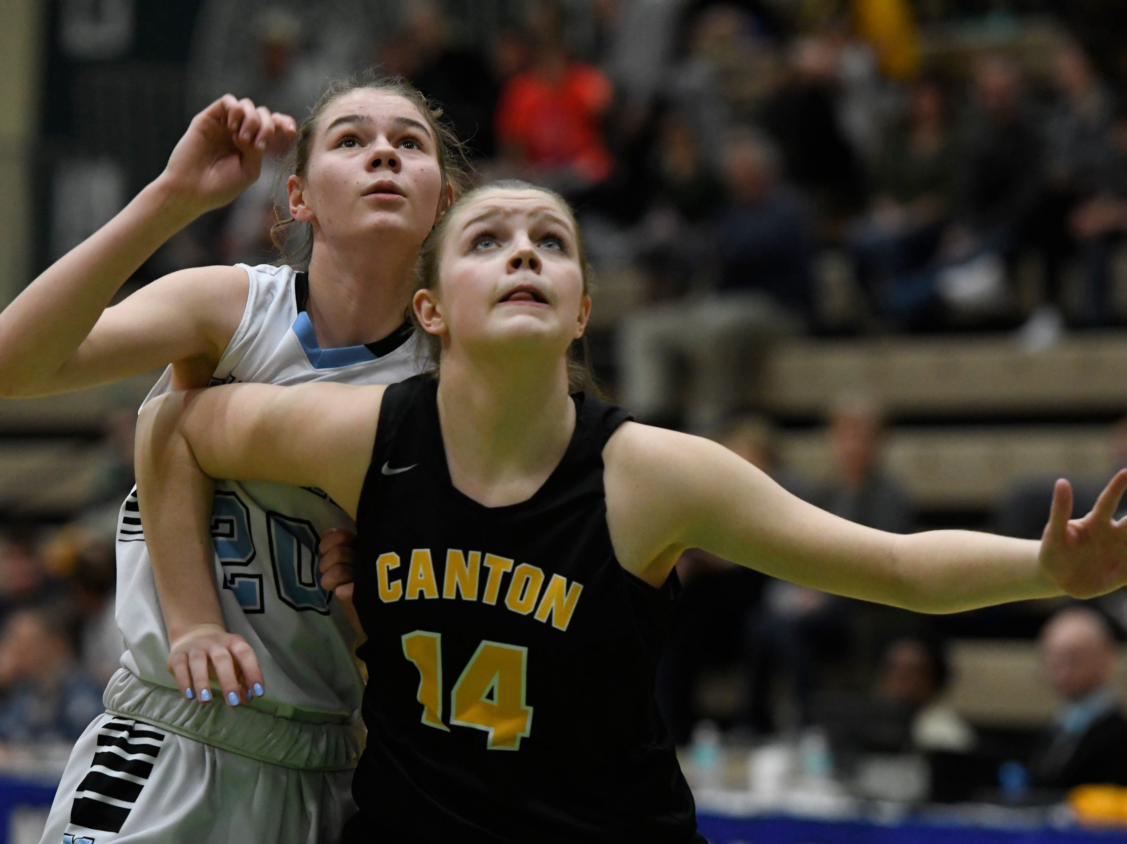 Midlakes's Callie Walker and Canton's Mary Lobdell battle for a rebound during their Class B State Semifinal at Hudson Valley Community College in Troy, N.Y. on Friday, Mar. 15, 2019.